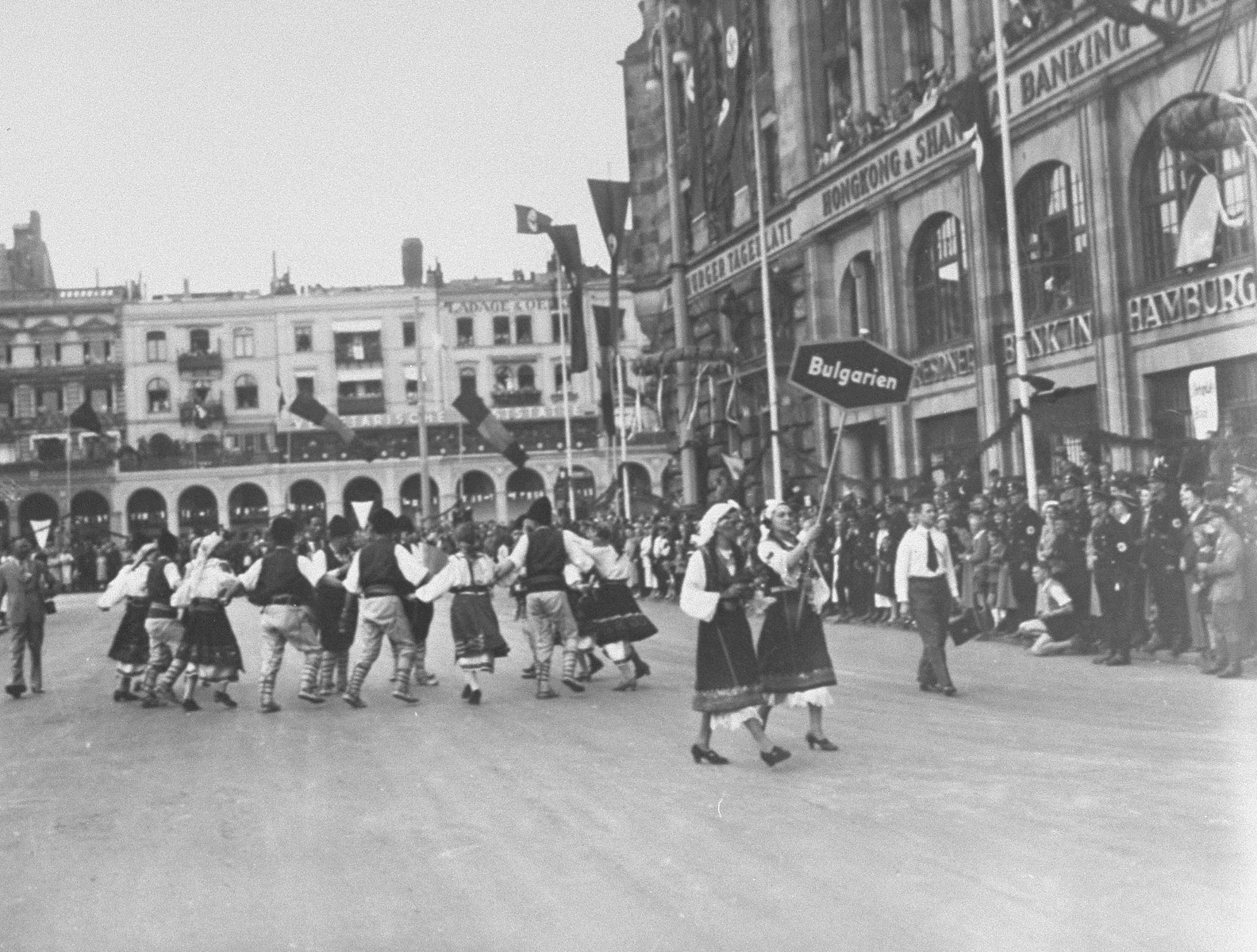 A troupe of dancers from Bulgaria entertain German spectators upon the arrival of the Bulgarian Olympic team in Germany.