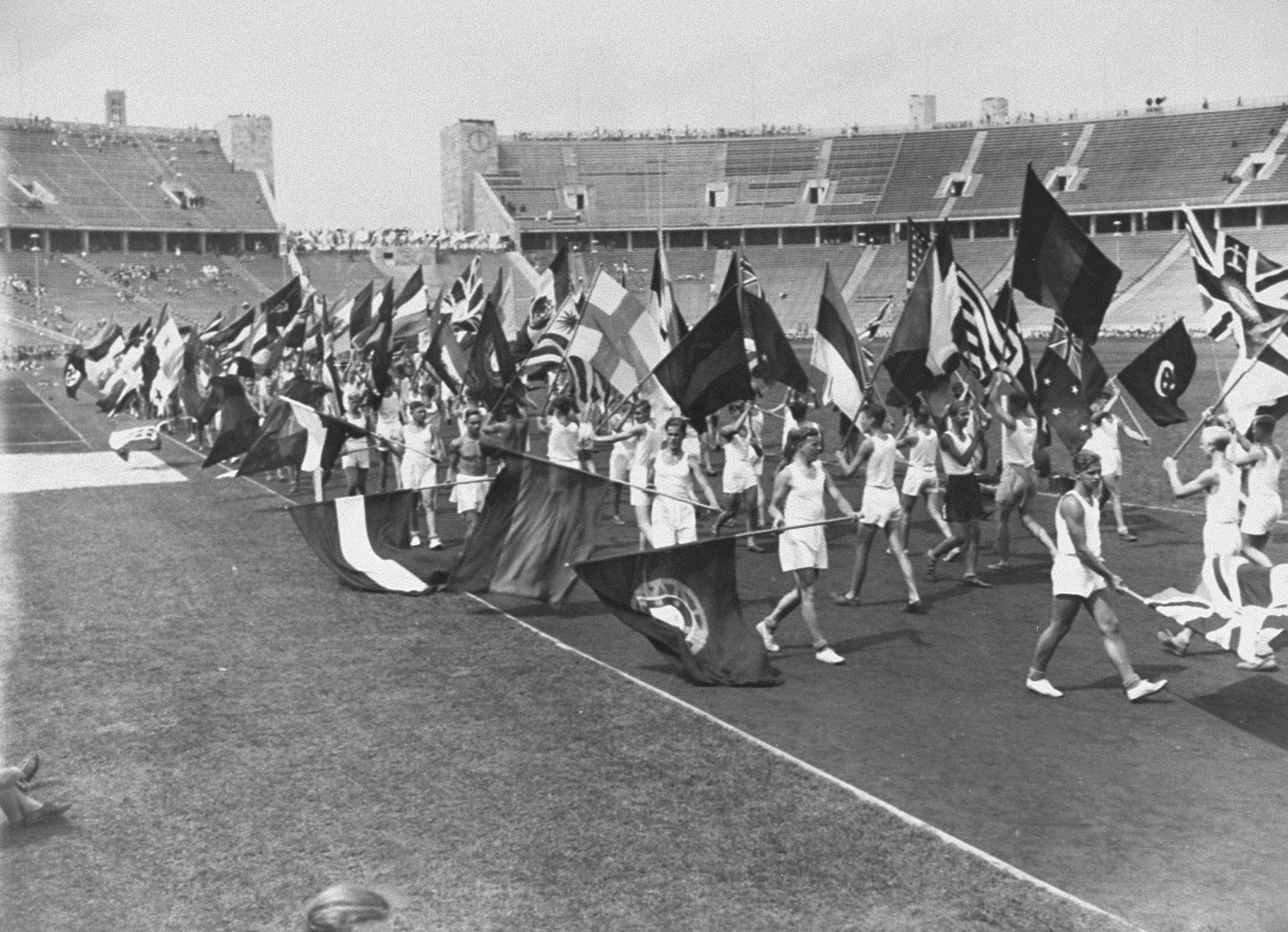 Flag carriers practicing for the parade that will open the 11th Olympiad.