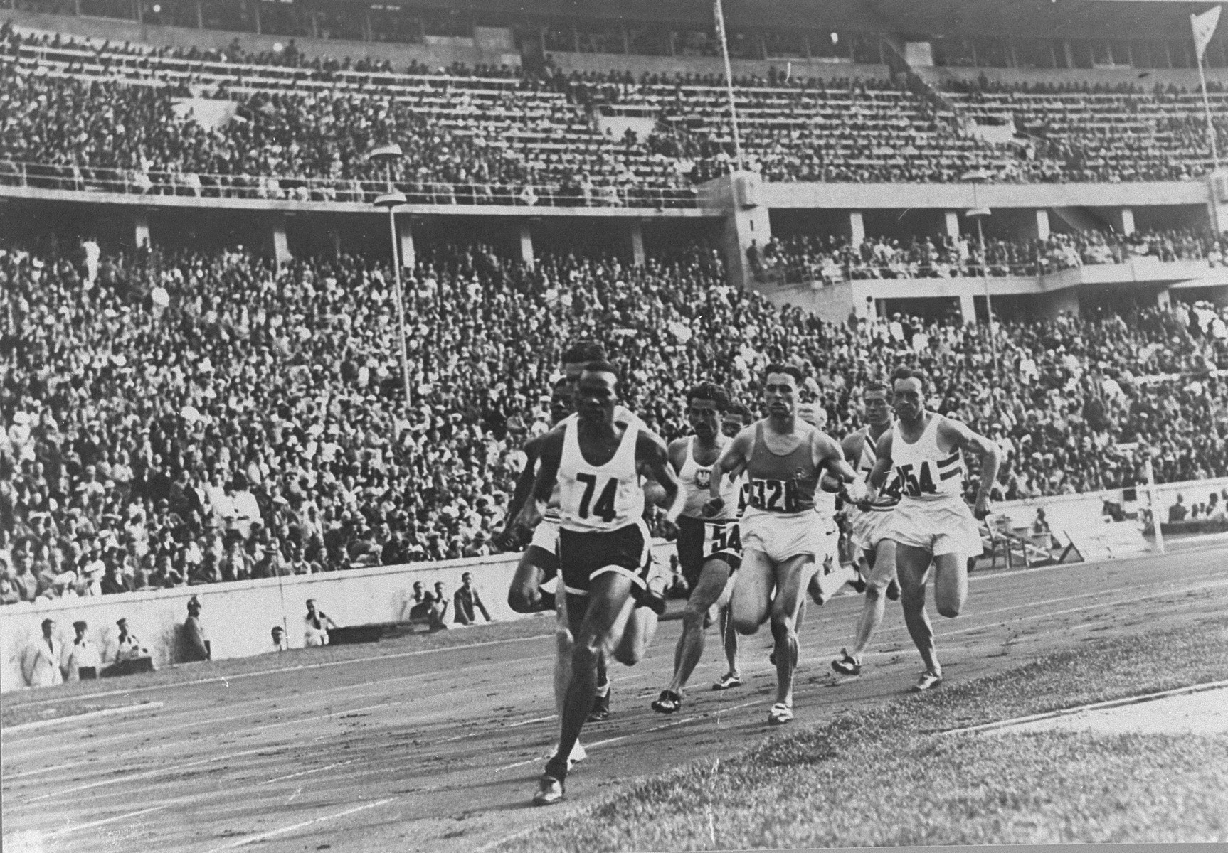 Runners competing in the 800m event at the Olympic games in Berlin.  Barely visible on the outside is American John Woodruff, who came from behind to win the race in 1 minute 52.9 seconds.
