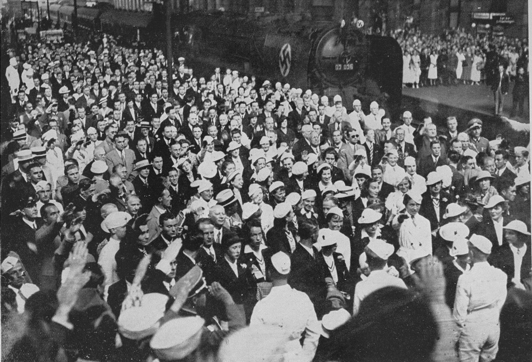 The U.S. Olympic team arrives at the railroad station in Berlin.