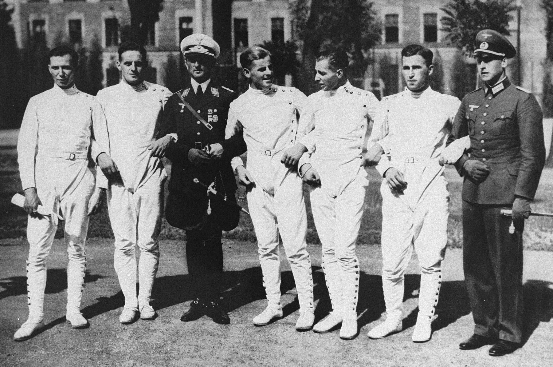 Group portrait of the members of the German Pentathalon team after their victory in Budapest.  This victory qualified the team to compete at the 1936 Berlin Olympics.  Pictured here, from left to right, are Oberlt. Birk, Oberlt. Handrick, Hauptmn. Heigl, Lt. Puttmann, Lt. Lemp, and Lt. Schreiber.