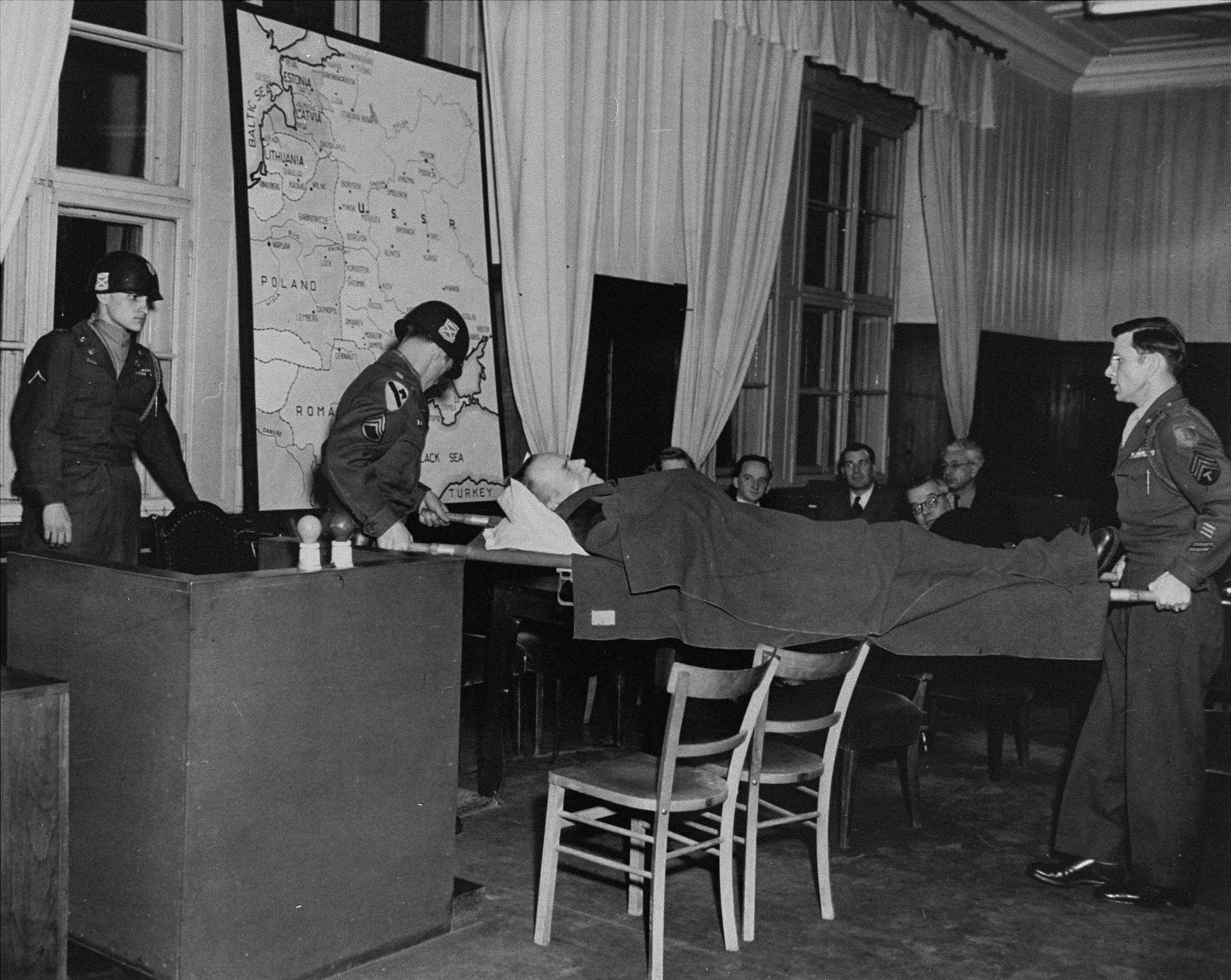 Defendant Otto Rasch gives testimony in a smaller courtroom in the Palace of Justice during the Einsatzgruppen Trial.    Due to his mental and physical instability, the case against him was discontinued on 5 February 1948 and he subsequently died on 1 November 1948.