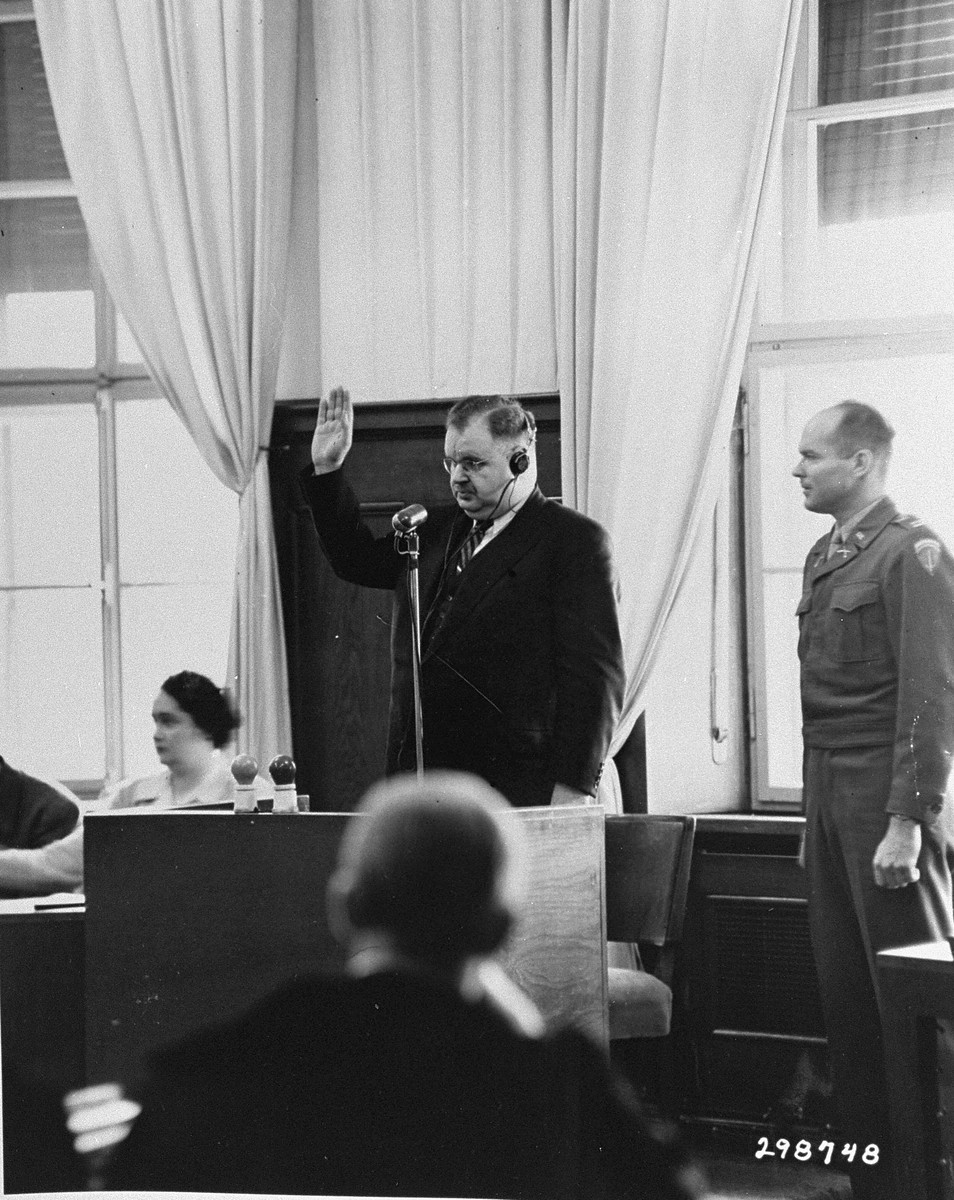 Philipp Auerbach is sworn in as a prosecution witness during the Ministries Trial.    Auerbach testified about his imprisonment in Auschwitz as a political prisoner.  He testified to the lining up of naked women by SS men and the shaving of their hair in the most brutal manner.  His testimony was directed against the defendant Berger who was Prisoner of War officer in the Reich Chancellory.  The defense had no questions to ask this witness.