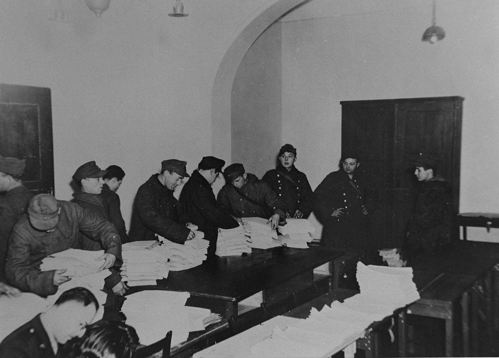 Former SS members are made to sort through captured records that will be presented as evidence before the International Military Tribunal war crimels trial at Nuremberg.