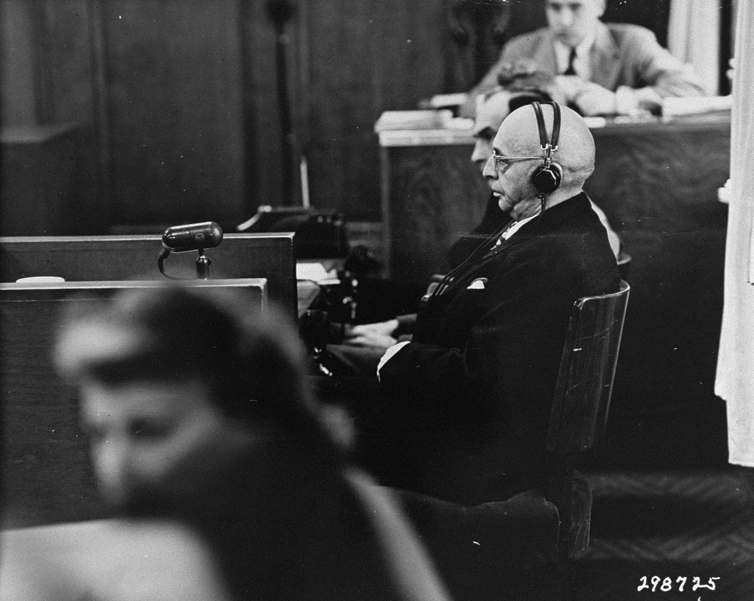 Justin Steinhauser, a German Jew and businessman, testifies against the defendants during the Ministries Trial.