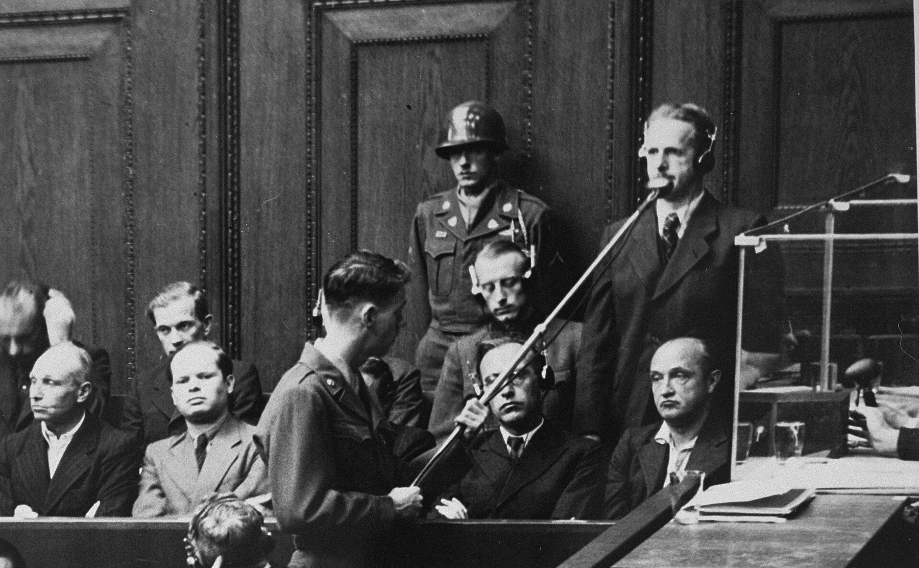 "Defendant Mathias Graf pleads ""not guilty"" during his arraignment at the Einsatzgruppen Trial."