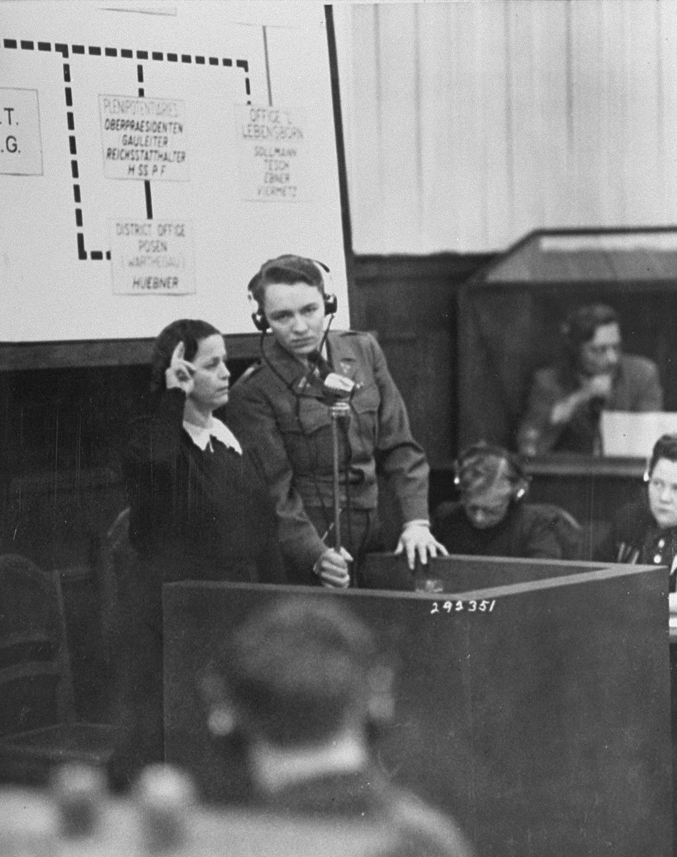 A Czech woman is sworn in as a witness in the RuSHA Trial.  She is testifying about the German massacre of the inhabitants of Lidice, Czechoslovakia.