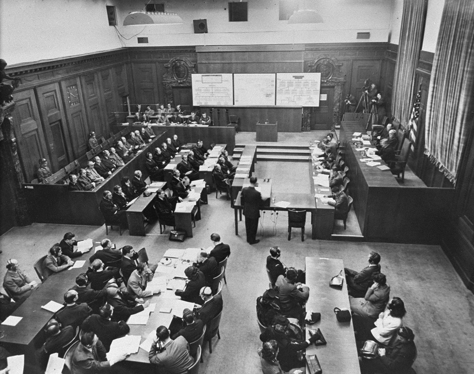 Brigadier General Telford Taylor (standing) opens the prosecution case against the 12 defendants of the huge Krupp works in the main court room, Palace of Justice, Nuremberg, Germany.