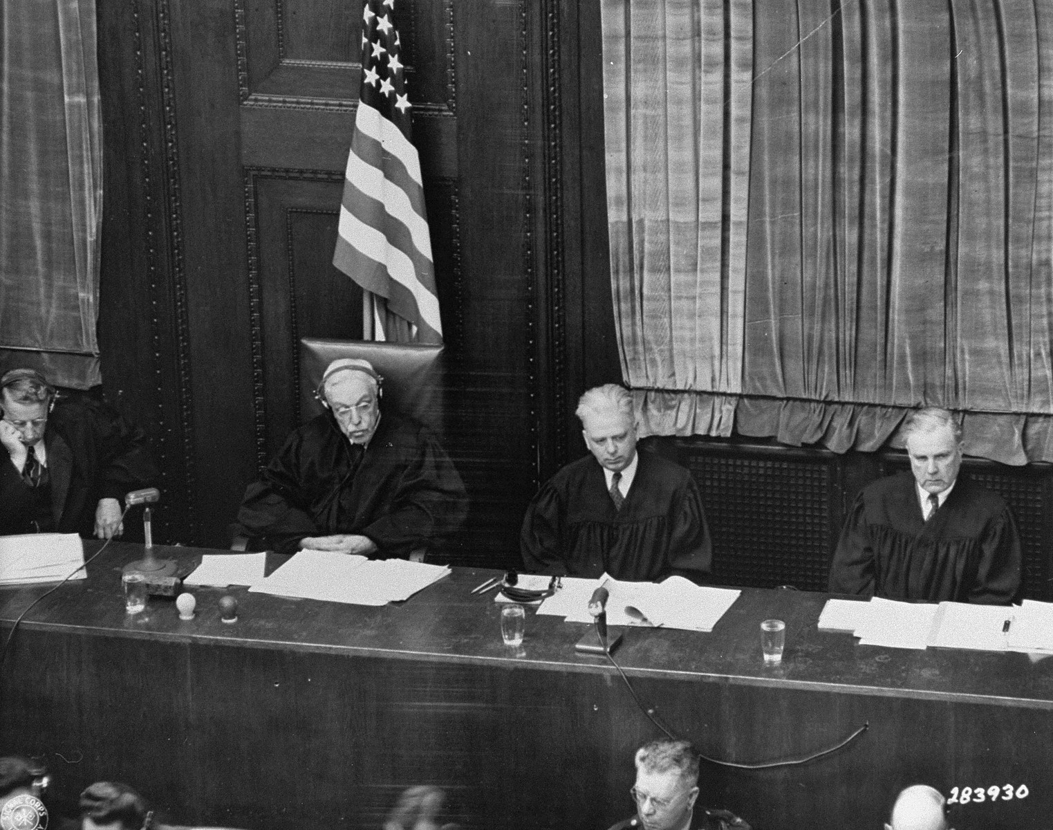 The judges of Military Tribunal IV at the Flick Trial.   Seated left to right are Frank N. Richman, Charles B. Sears, William C. Christianson, and Richard D. Dixon.