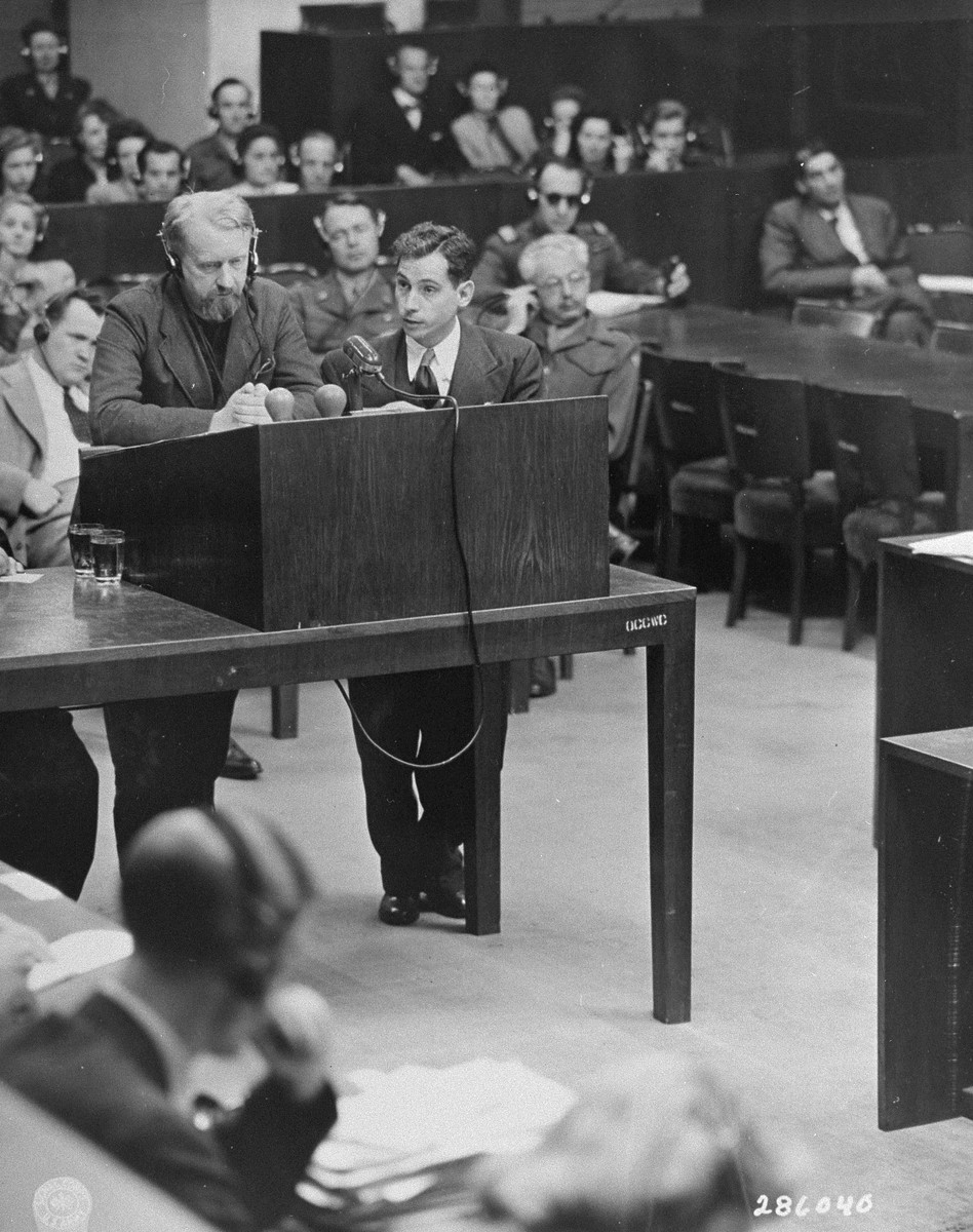 Chief Prosecutor James M. McHaney examines defendant Dr. Gerhard Rose at the Doctors Trial.