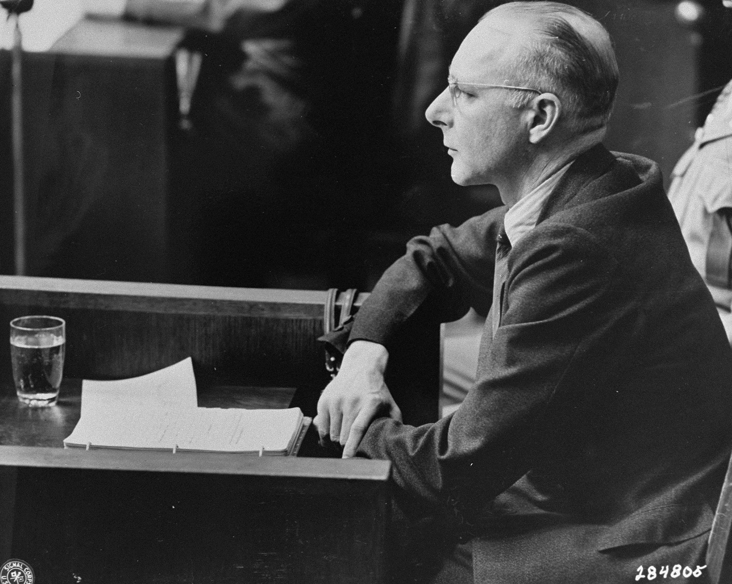 Victor Brack on the first day of his testimony in his own defense during the Doctors Trial.    Brack served as the Chief Administrative Officer of the Chancellery during the war.