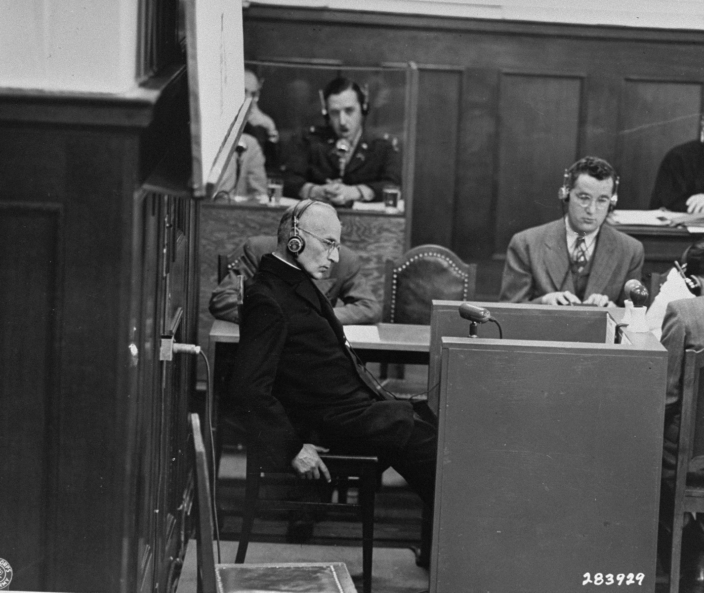 Benedict Wein, a priest from Amberg prison, gives testimony as a witness for the prosecution during the Justice Case.  The testimony took place in a room in the Palace of Justice outside the main courtroom.