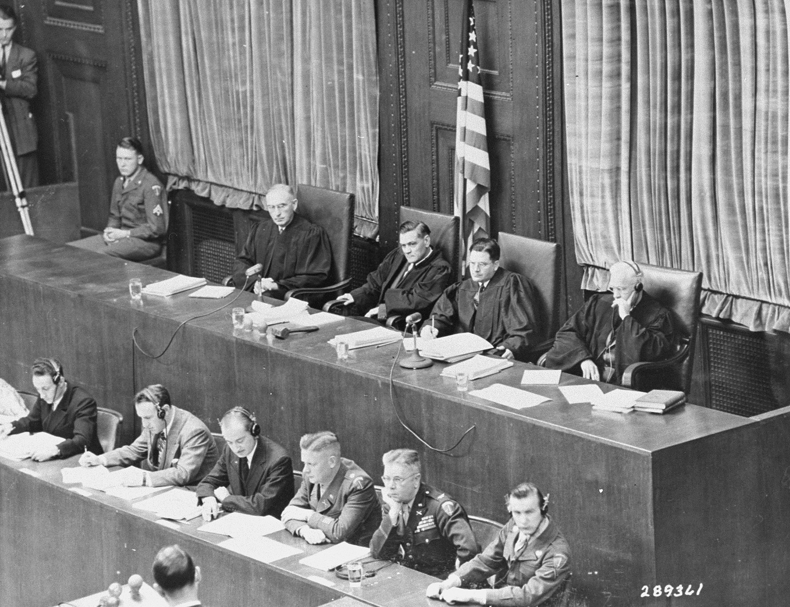 The four judges of Military Tribunal VI on the first day of the I.G. Farben Trial.  From left to right are James Morris, Curtis G. Shake, Paul M. Hebert, and Clarence F. Merrell.