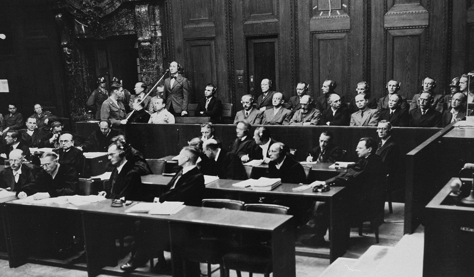 Defendant Gustav Nosske pleads not guilty during his arraignment at the Einsatzgruppen Trial.
