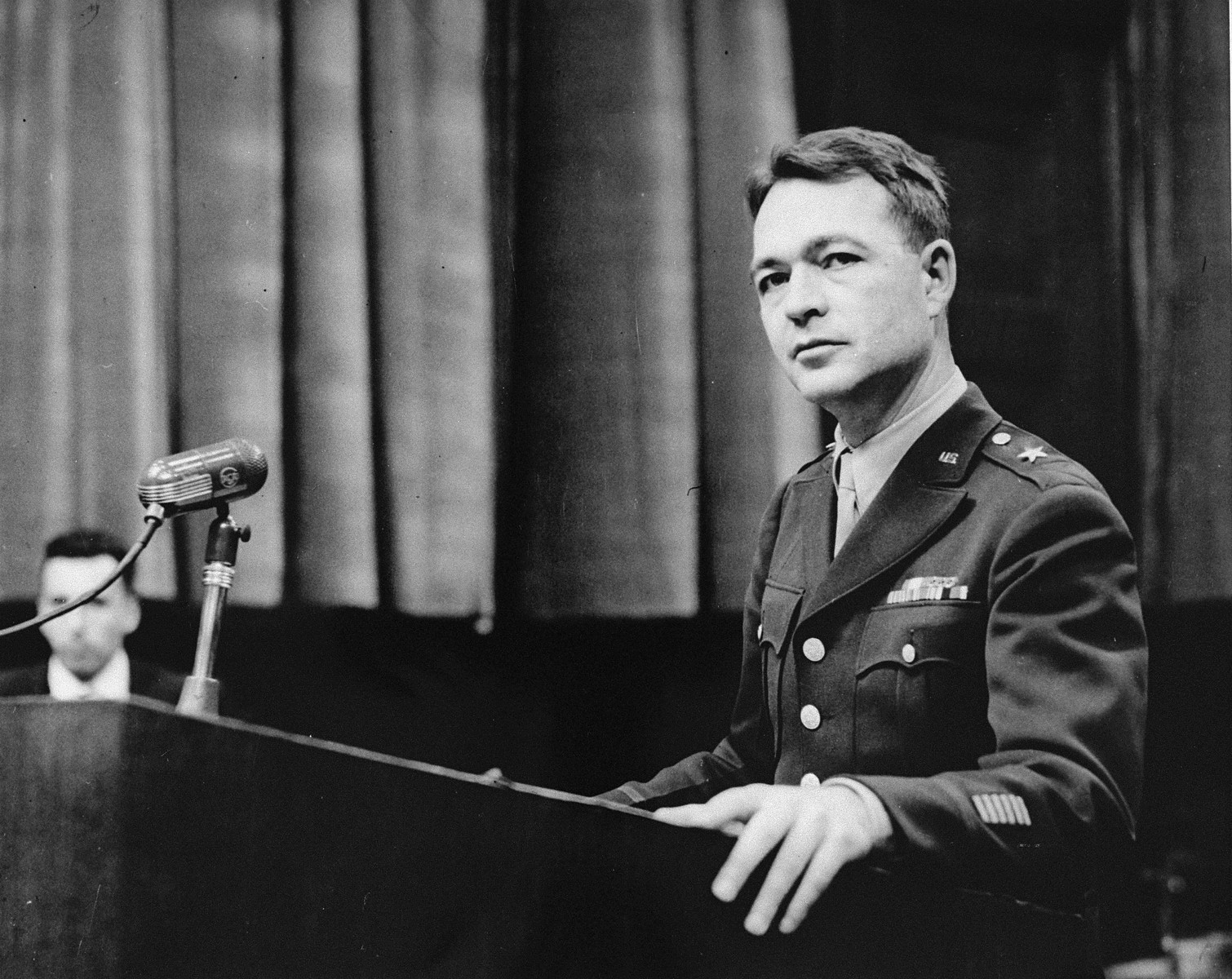 Brigadier General Telford Taylor, the Chief of Counsel for the prosecution, addresses the court at a session of the Medical Case (Doctors') Trial in Nuremberg.