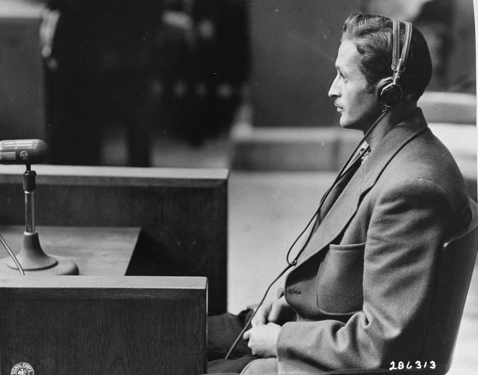 Ernst Mettbach testifies as a witness for defendant Wilhelm Beiglboeck at the Doctors Trial.  Mettbach stated he and thirty-nine other Gypsies volunteered for sea-water experiments.