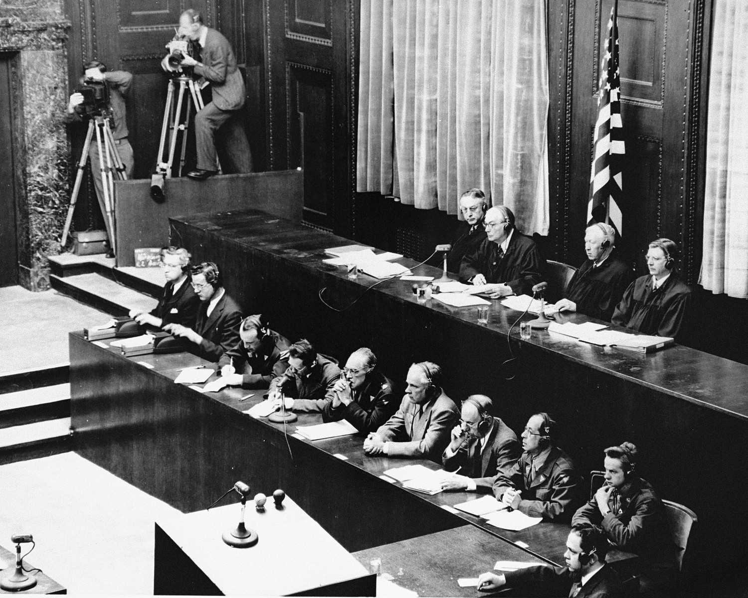 View of the tribunal during a session of the Medical Case (Doctors') Trial in Nuremberg.  In the foreground are the court reporters.