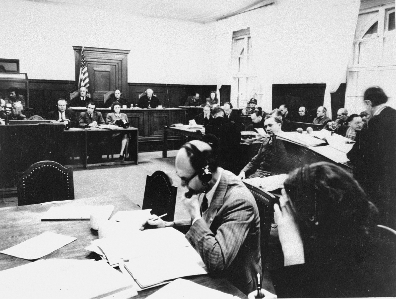 View of the courtroom during a session of the RuSHA Trial.    The judges are seated in the rear and the defendants are seated in the dock at the right.