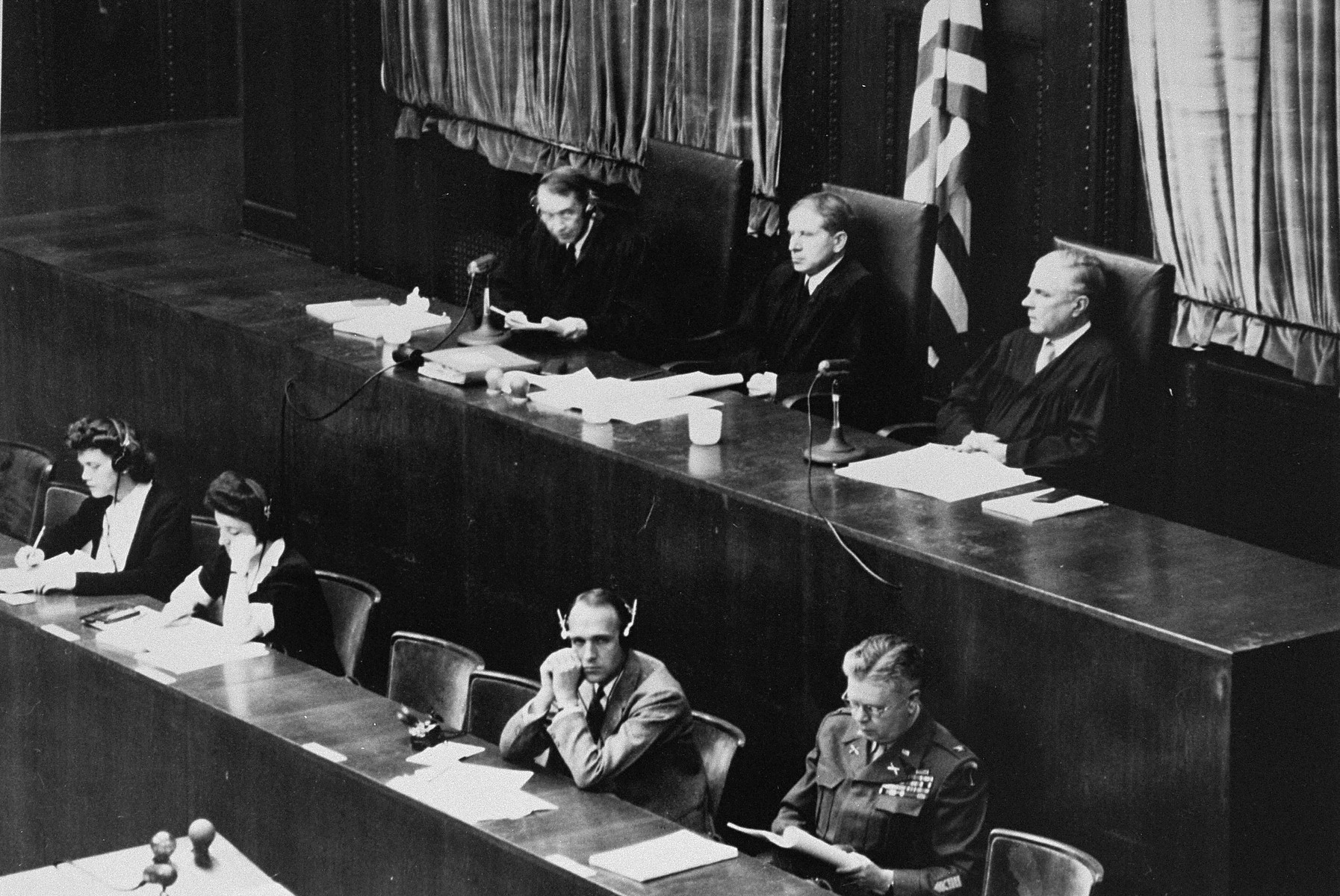 The judges of Military Tribunal II-A, hearing the Einsatzgruppen Trial.  Pictured left to right are John J. Speight, Michael A. Musmanno, and Richard D. Dixon.