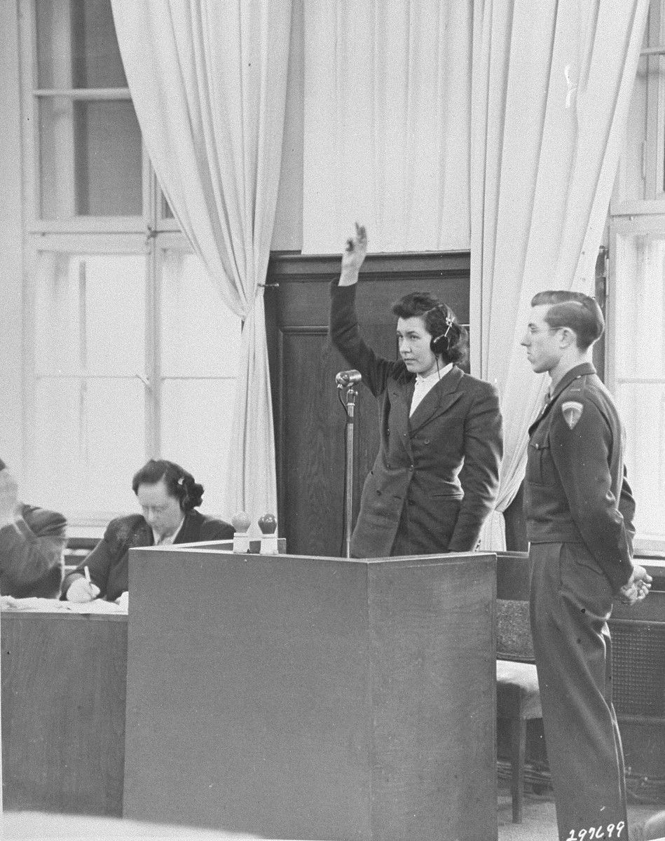 Herta Jauer is sworn in as a witness for the defense at the Einsatzgruppen Trial.
