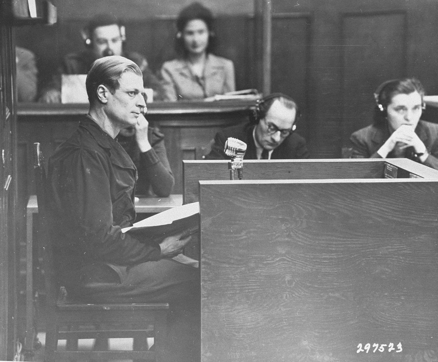 """Dr. Hans Hilmar Staudte, a former """"race examiner"""" in the Rasse- und Siedlungshauptamt, the Race and Settlement Office, testifies as a defense witness at the RuSHA Trial."""
