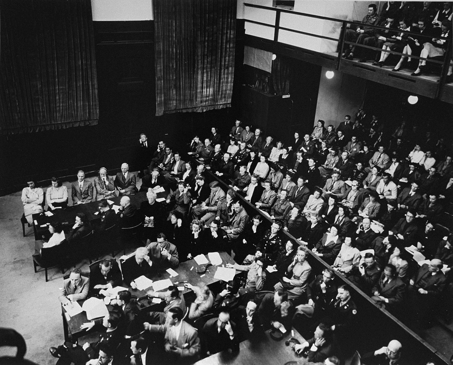 The prosecution lawyers (left) and the spectators gallery (right) at the Einsatzgruppen Trial.