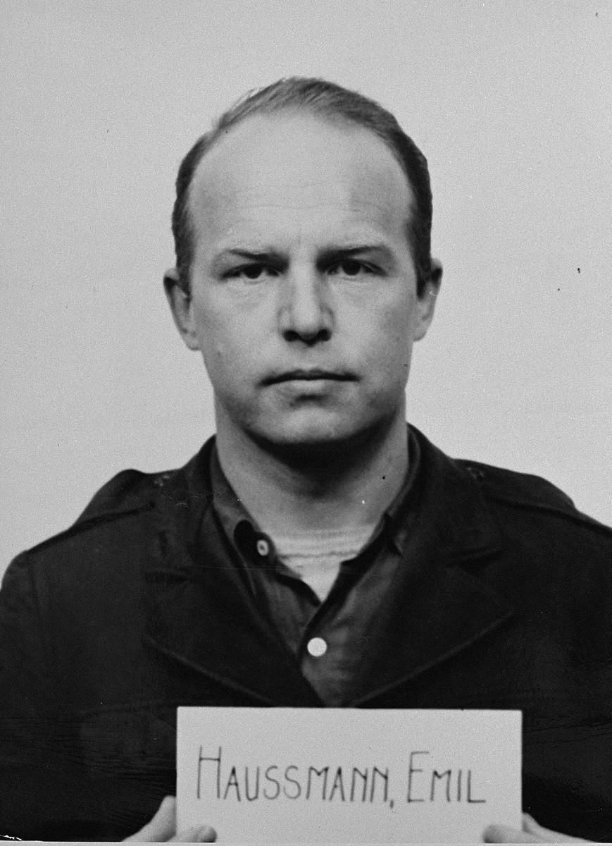 Defendant Emil Haussmann at the Einsatzgruppen Trial.  Haussmann was an officer of Einsatzkommando 12 of Einsatzgruppe D.  He committed suicide on 31 July 1947, before the trial began.
