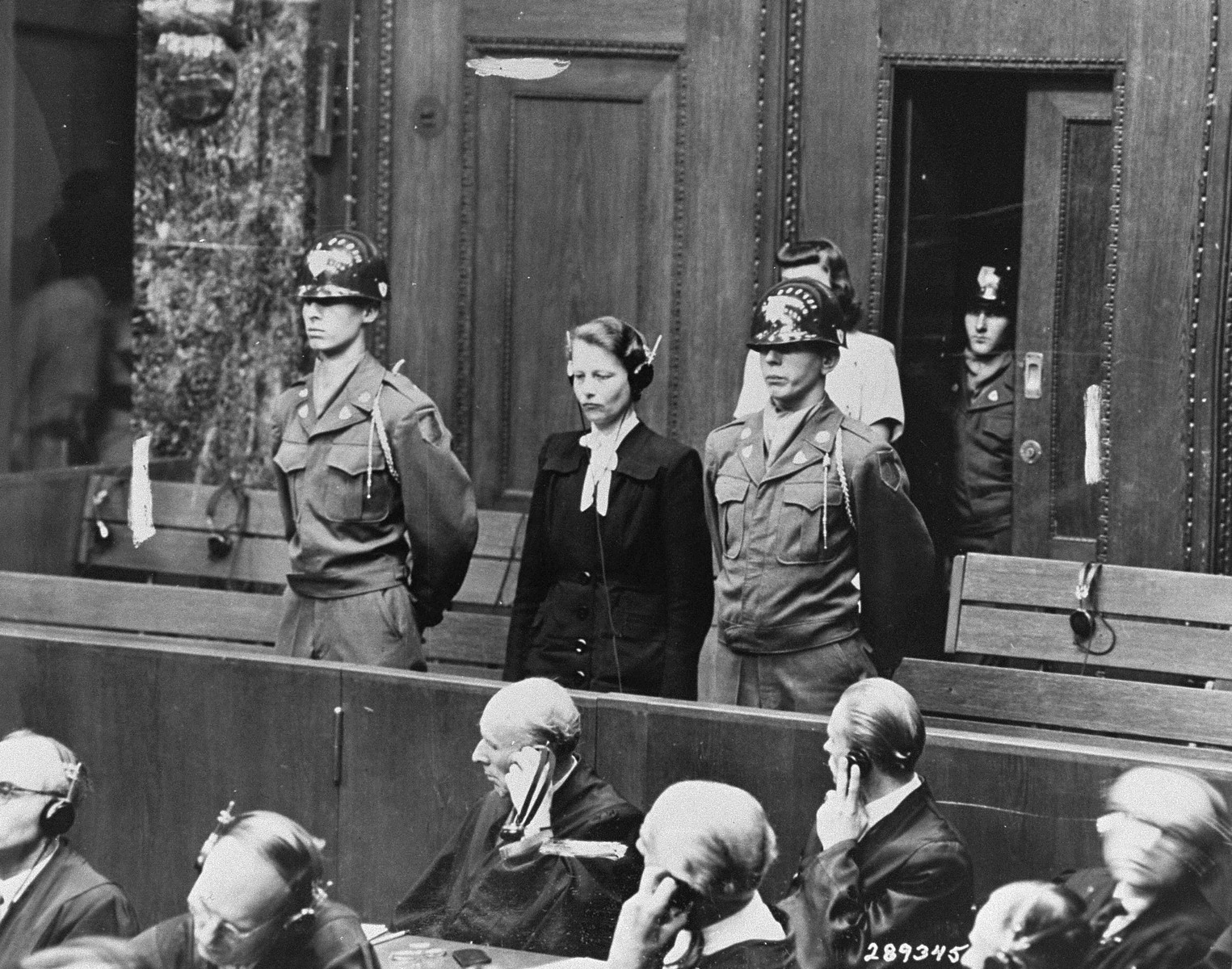 Defendant Herta Oberhauser is sentenced to twenty years in prison by the Military Tribunal I at the Doctors Trial.