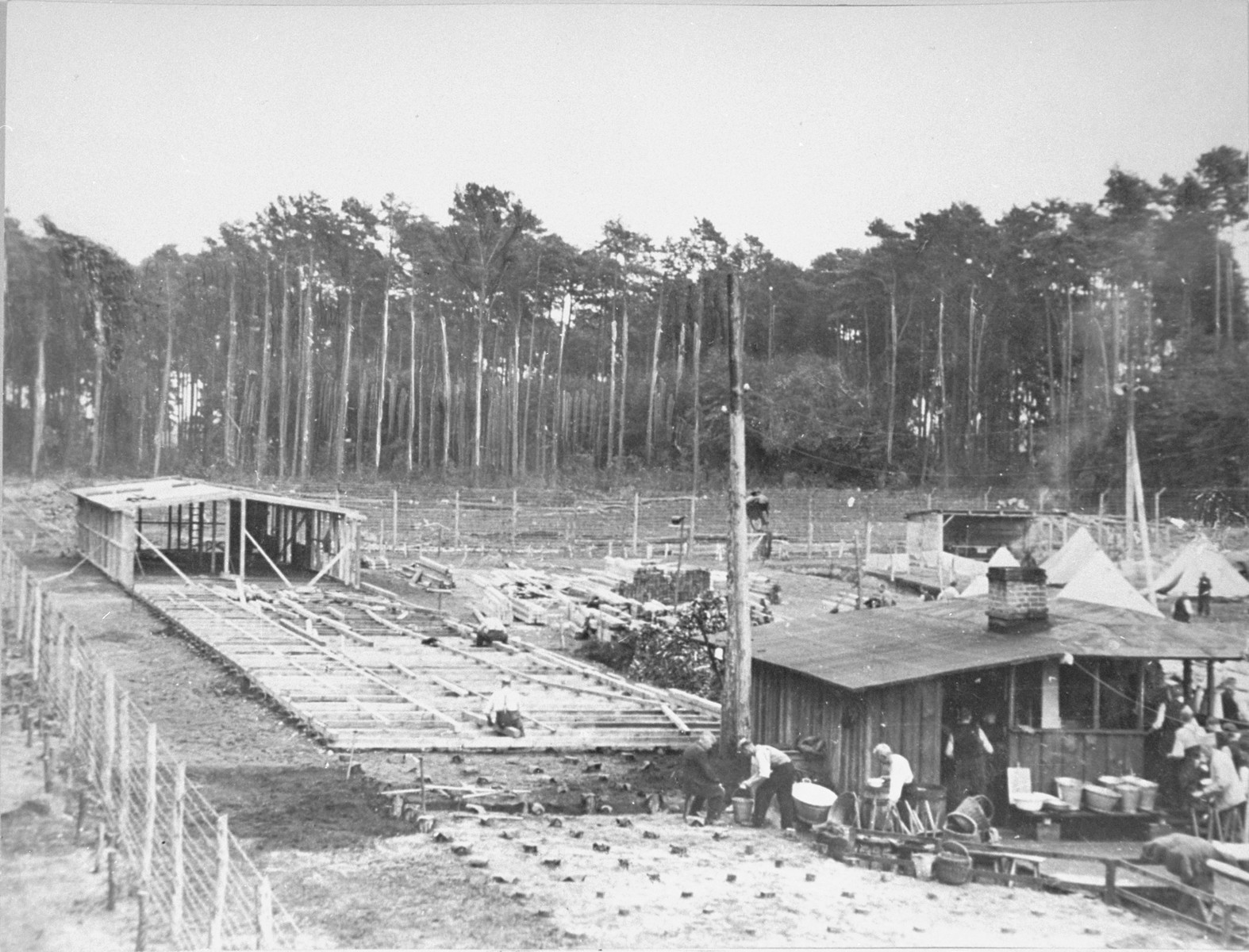 Prisoners engaged in the construction of foundations for future barracks.