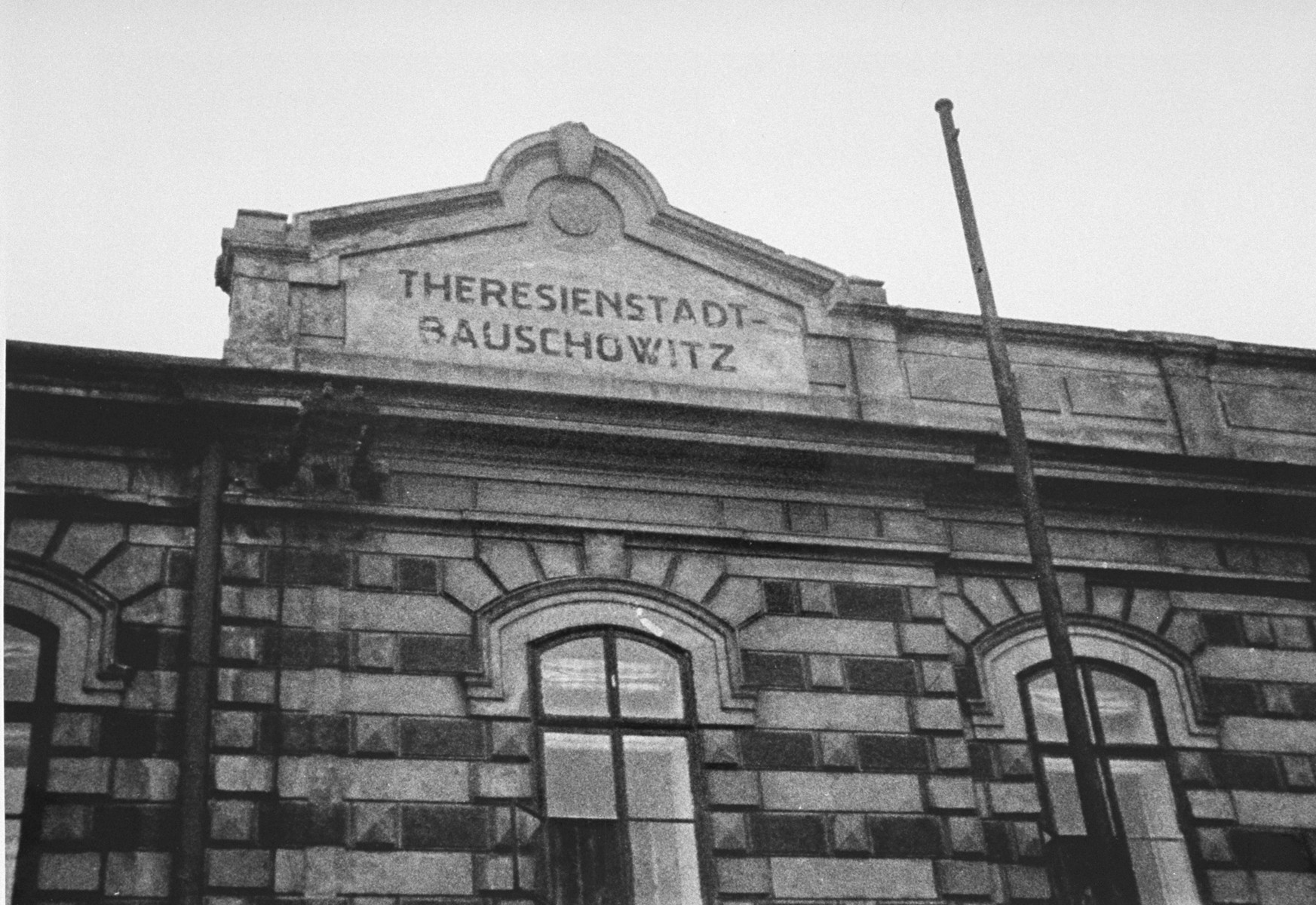 View of the sign atop the train station in Theresienstadt-Bauschowitz (Bohusovice) taken during the arrival of a transport of Dutch Jews to Theresienstsadt in January, 1944.  [oversized photo]