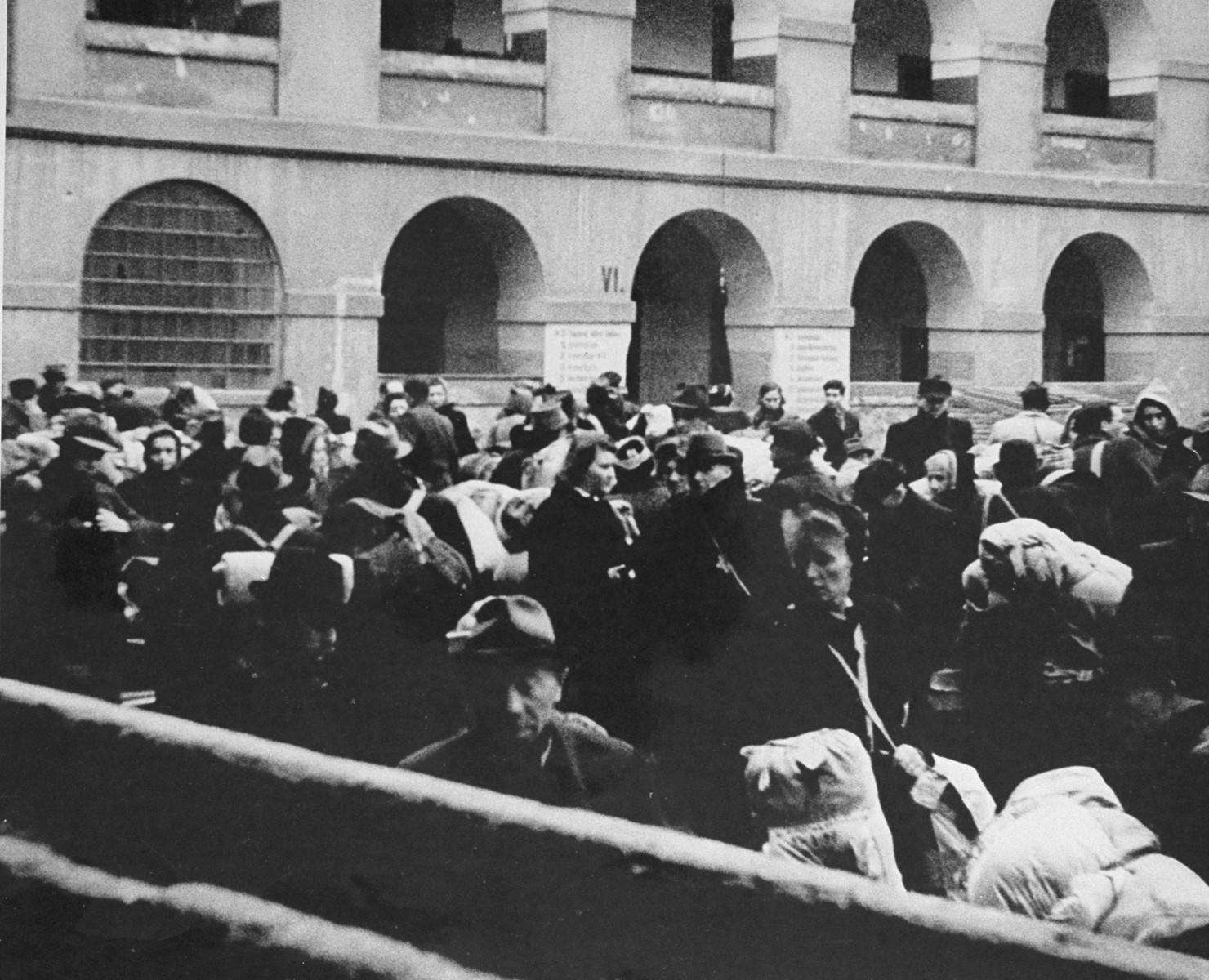 Members of a transport of Dutch Jews that has just arrived in Theresienstadt are gathered in the courtyard of the ghetto. [oversized photo]