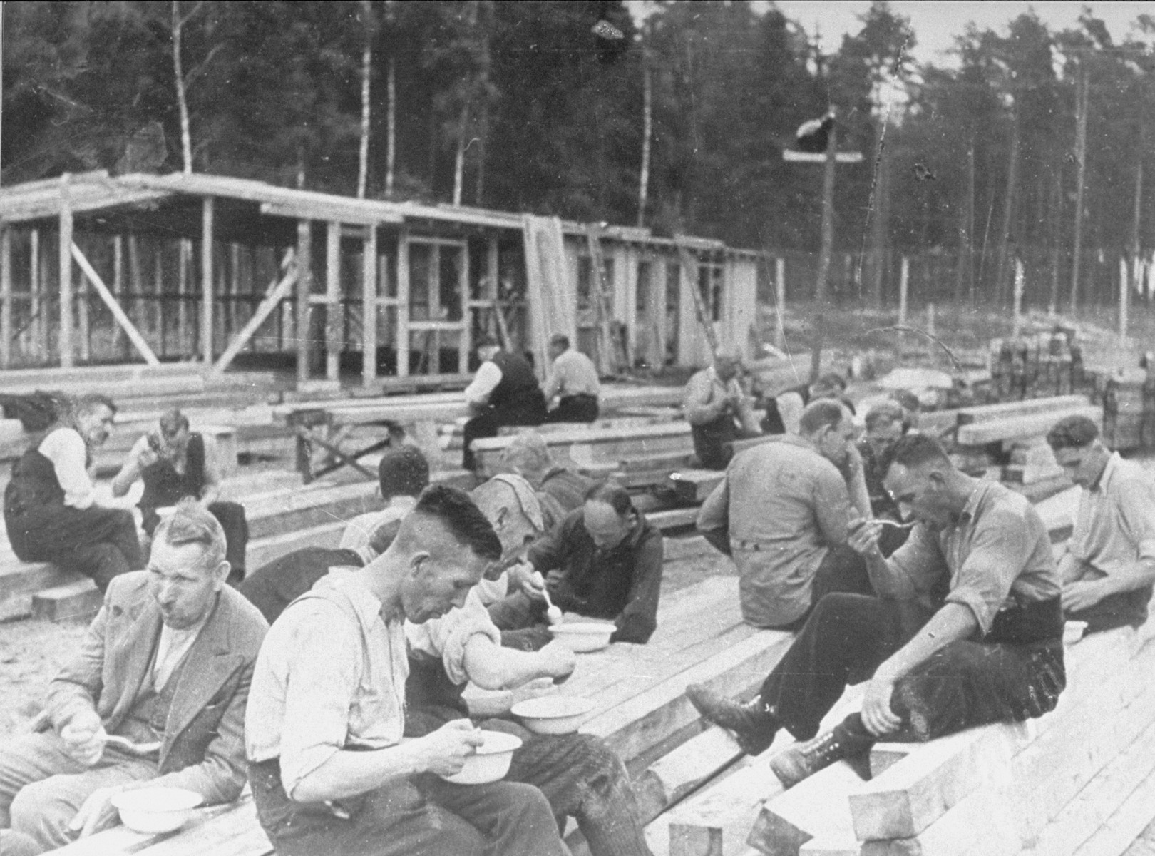 The first prisoners at Stutthof eat during a break in the construction of the camp.