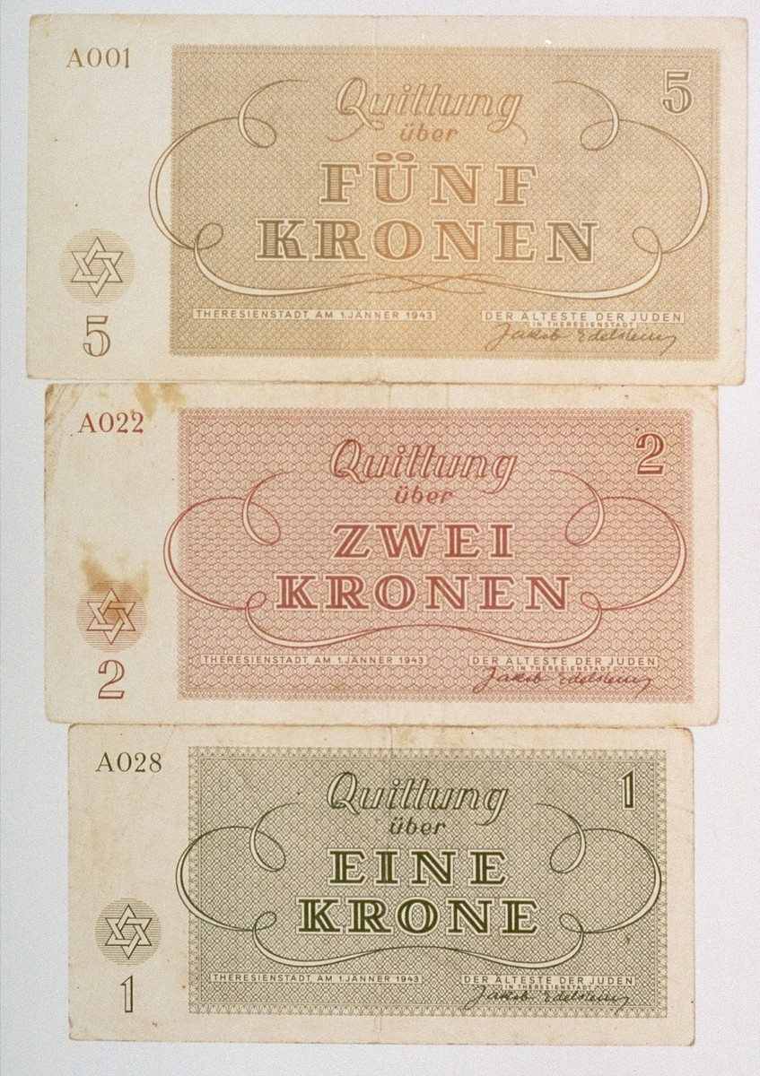 Theresienstadt ghetto currency.   These notes were issued by the Aeltestenrat (Council of Elders) of the Theresienstadt ghetto and bear the signature of the Judenaelteste (chairman of the Council of Elders), Jacob Edelstein.  The design was the work of a ghetto inmate, the architect and graphic artist Maximilian Spell (Spiegel), who copied the motif of Moses and the Ten Commandments from the amulet given to him by his mother before he left for Theresienstadt.  Spell survived the war and settled in Israel.  [Source: The Jews of Czecholoslovakia, Vol. III, Jewish Publication Society of America, 1984]