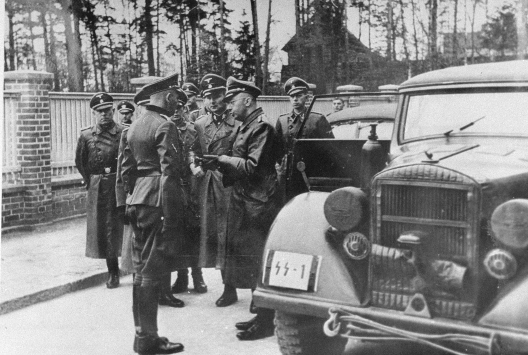 Reichsfuehrer-SS Heinrich Himmler greets SS Sturmbannfuehrer and camp commandant Max Pauly during an official visit to Stutthof.