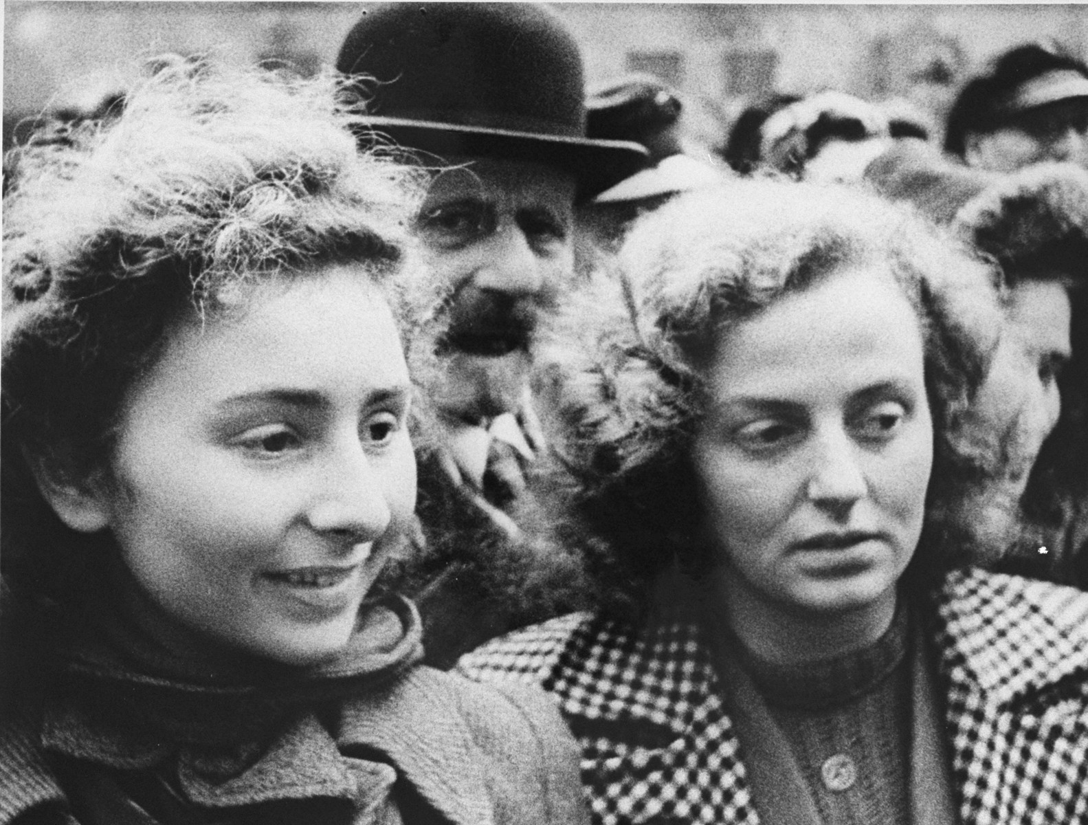 Two young women who have just arrived in Theresienstadt with a transport of Dutch Jews, wait in the courtyard of the ghetto.  [oversized photo]