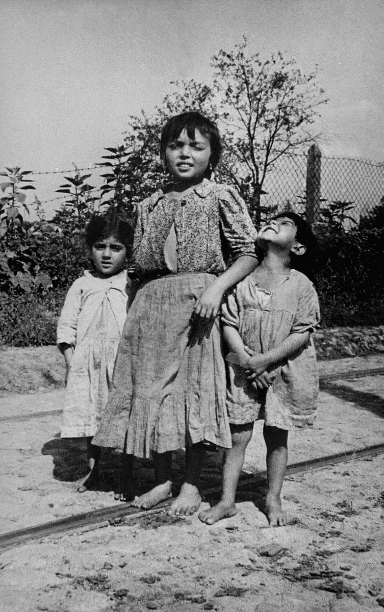 Three Romani children in hiding during the German occupation.