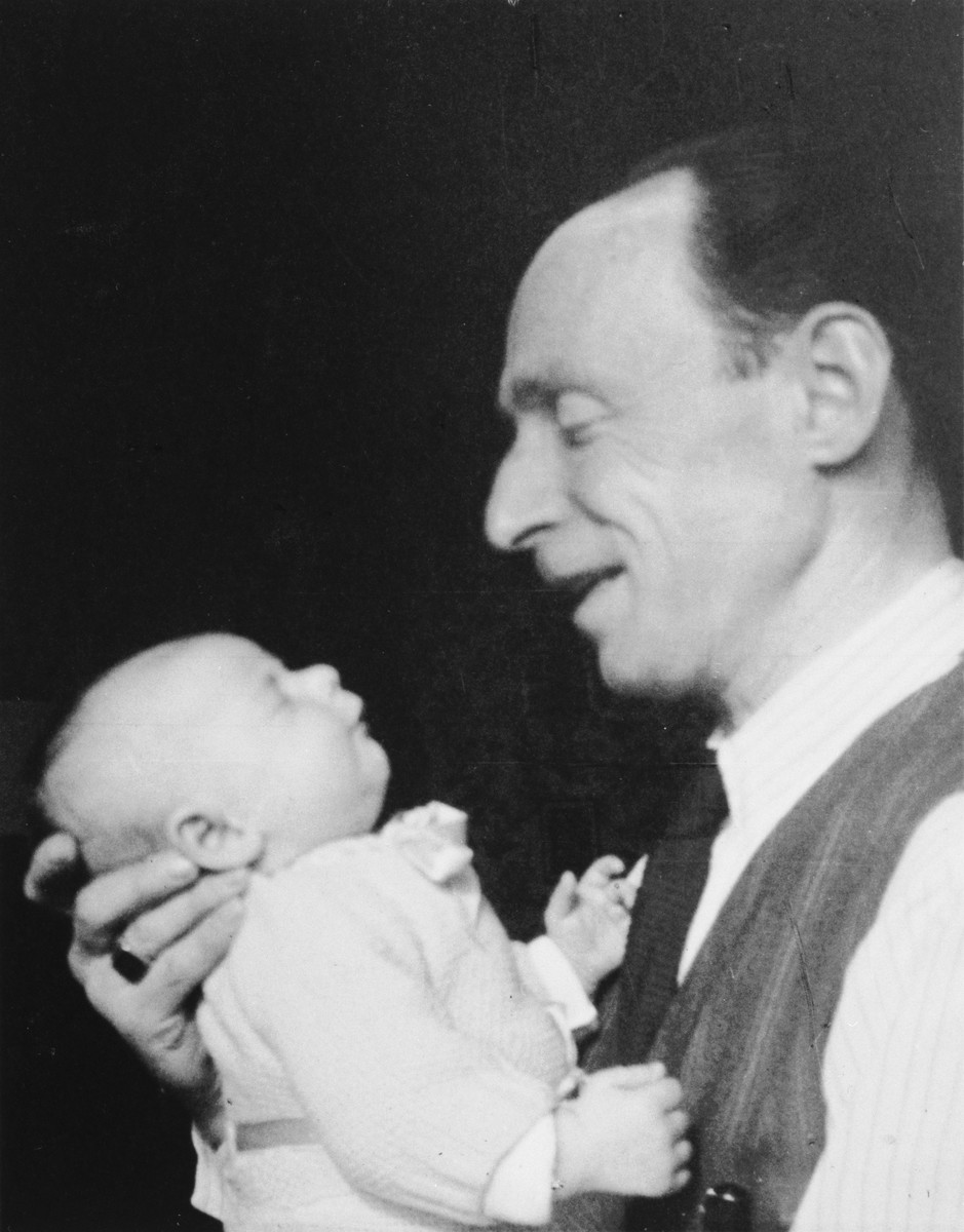 [Lazarus?] Birnbaum holds his newborn daughter, Marguerite-Rose.