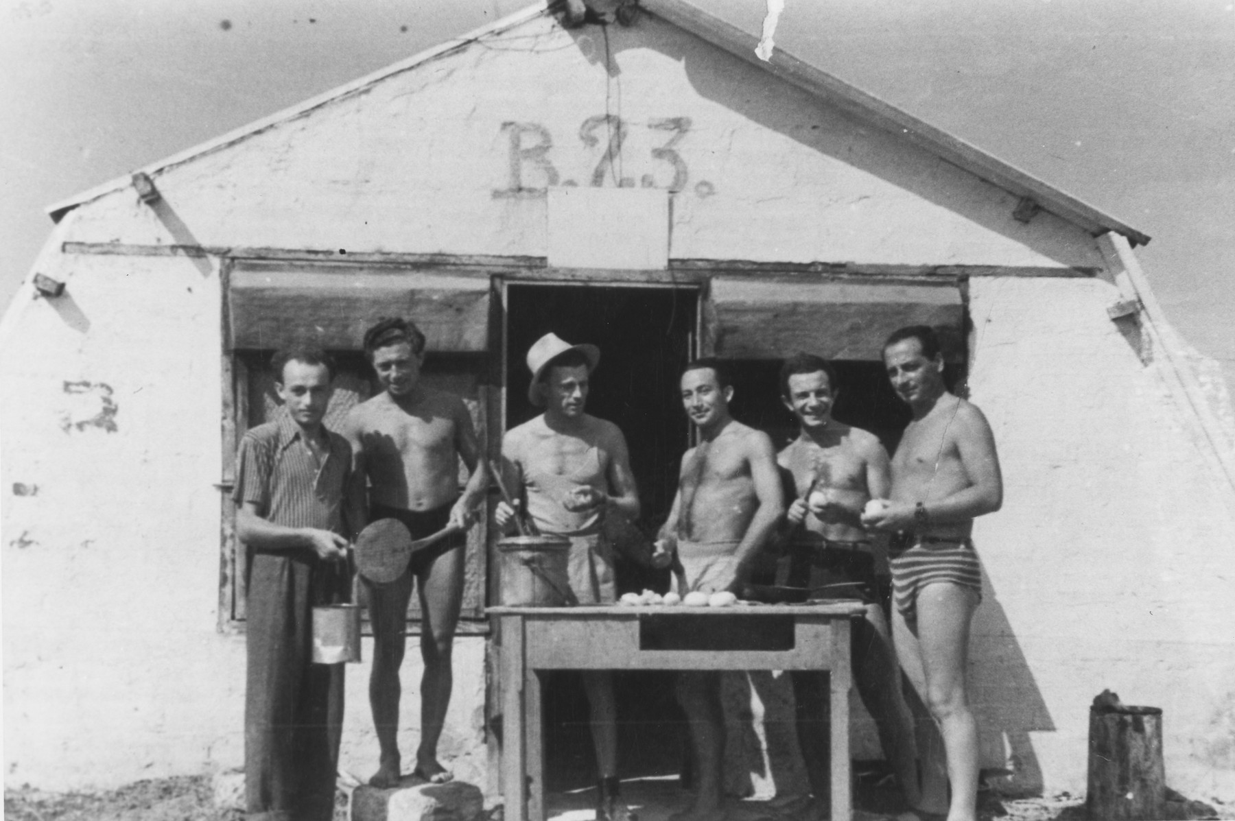 Jewish DPs peel potatoes outside barracks 23 in Santa Maria di Leuca.  Pinkus Gipsman is pictured second from the left.