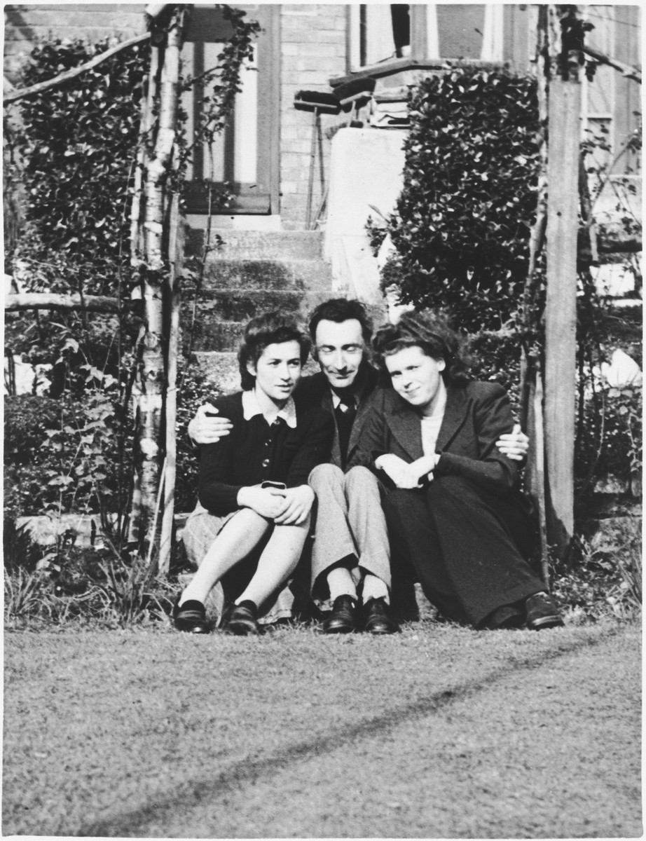 Ruth Cohn and her future husband, Karl Terner, sit with another young women on the steps of a boarding house in Birmingham, England.
