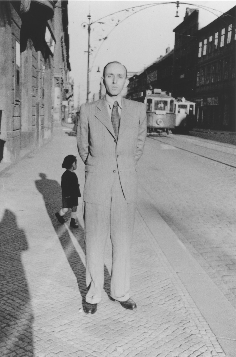 Norbert Hermann, the son of a Catholic mother and a baptized Jewish father, poses on a street in Prague during the German occupation.   Norbert Hermann served in the German army from 1939 to 1940, but was expelled after being classified as a Mischling.  He was not, however, required to wear a Jewish badge.