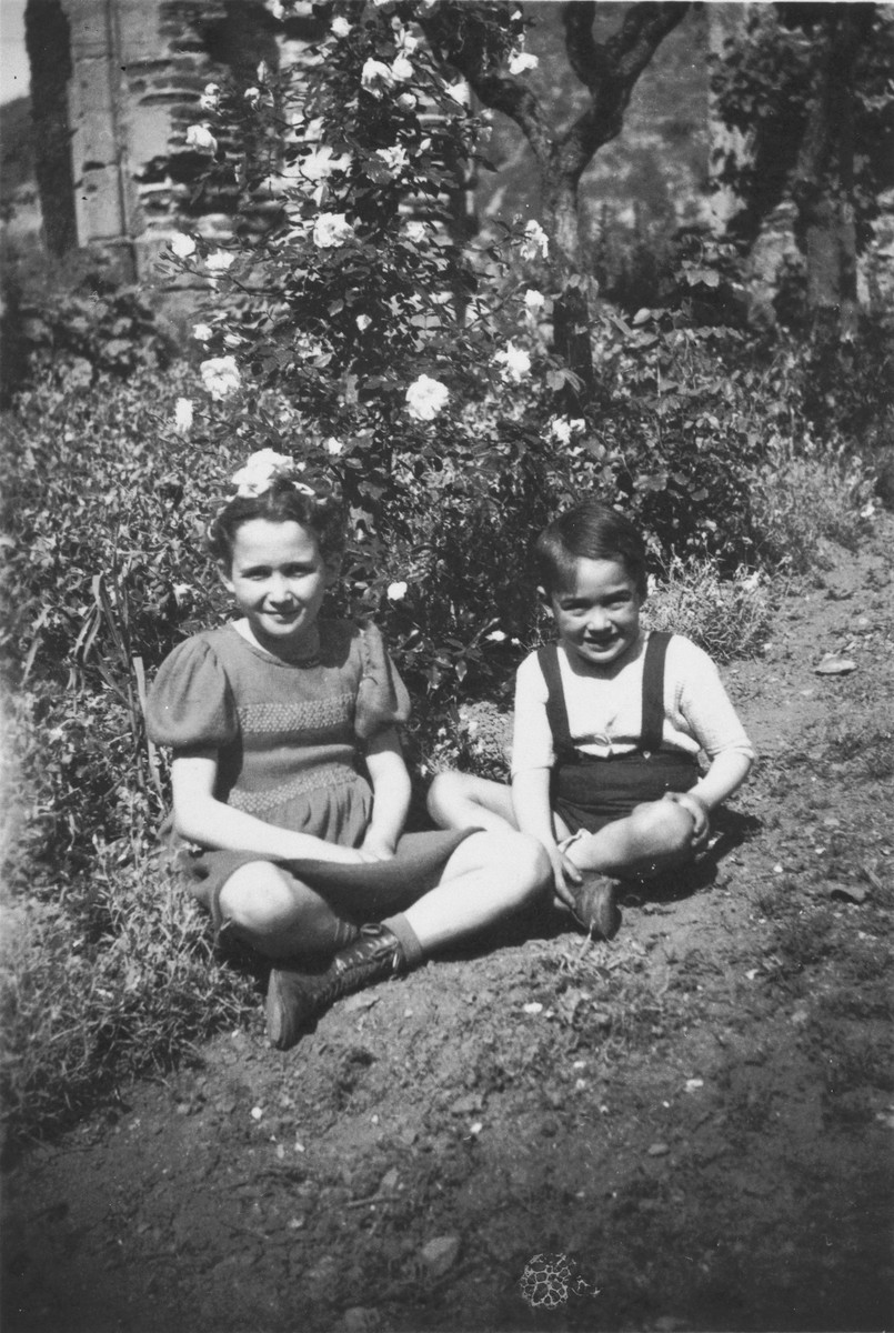 Denise and Jean-Claude Bystryn sit in front of the convent in Cahors in 1943 where they were hidden.
