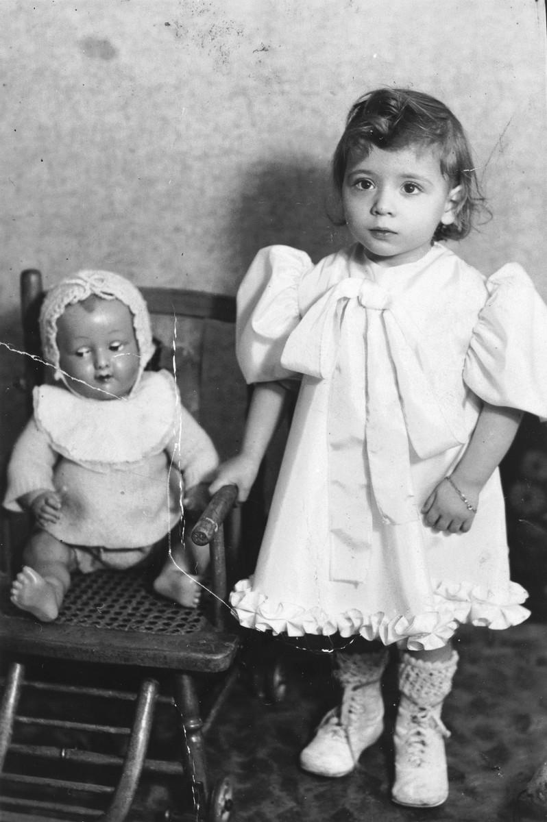 Blanche Karakowski stands next to her doll.