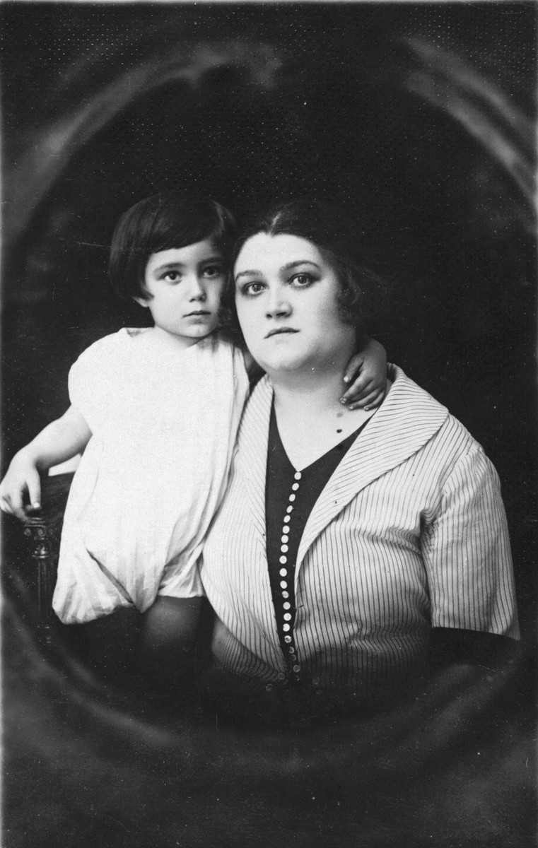 Studio portrait of a Jewish mother and son in Mukachevo, Czechoslovakia.  Pictured are Zeni Farbenblum and her son, Rudy.