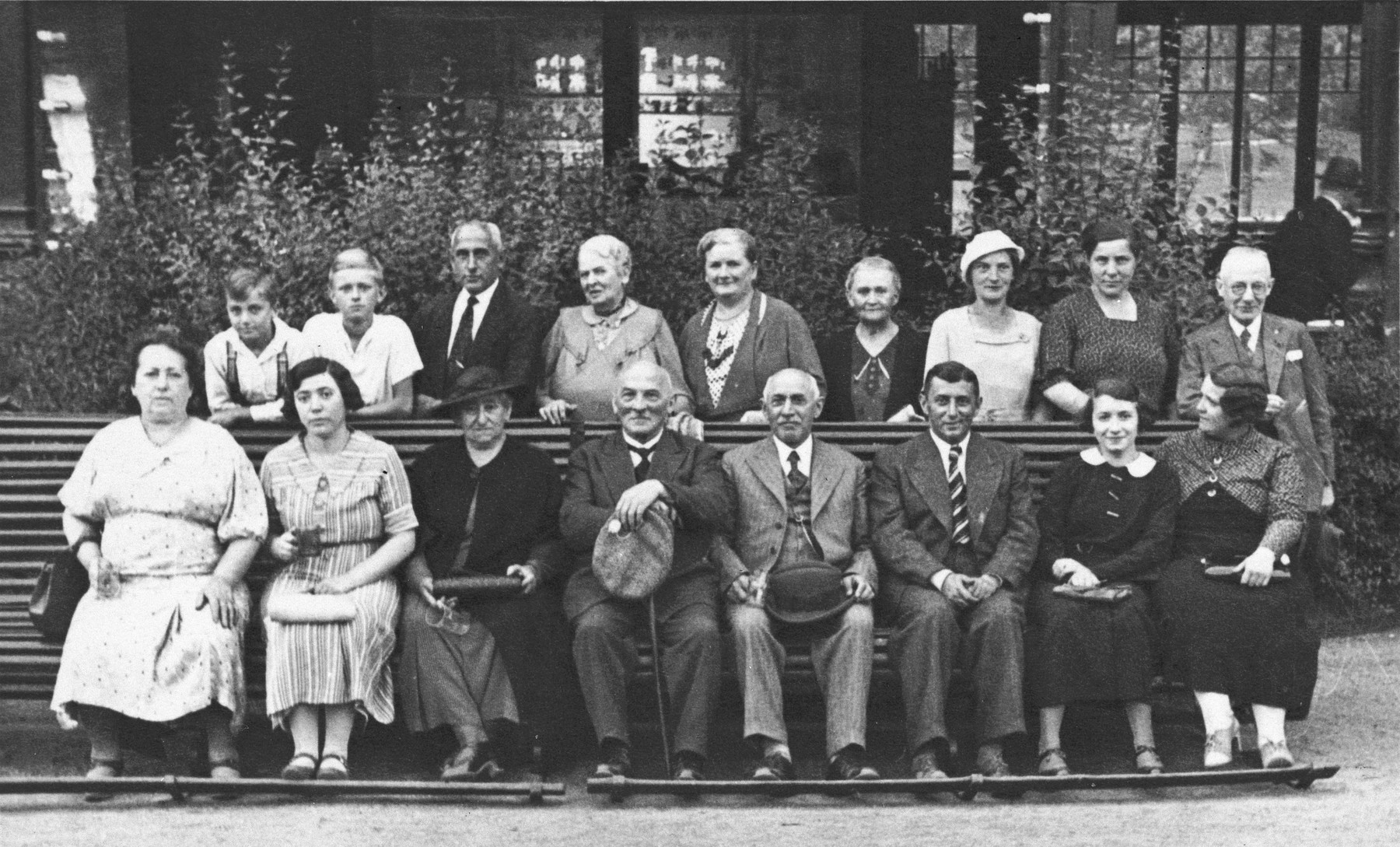 Group portrait of German-Jews seated and standing by a park bench in Berlin.  Among those pictured are Sara and Simon Deutschkron (first row, third and fourth from the left), grandparents of Ruth Cohn.