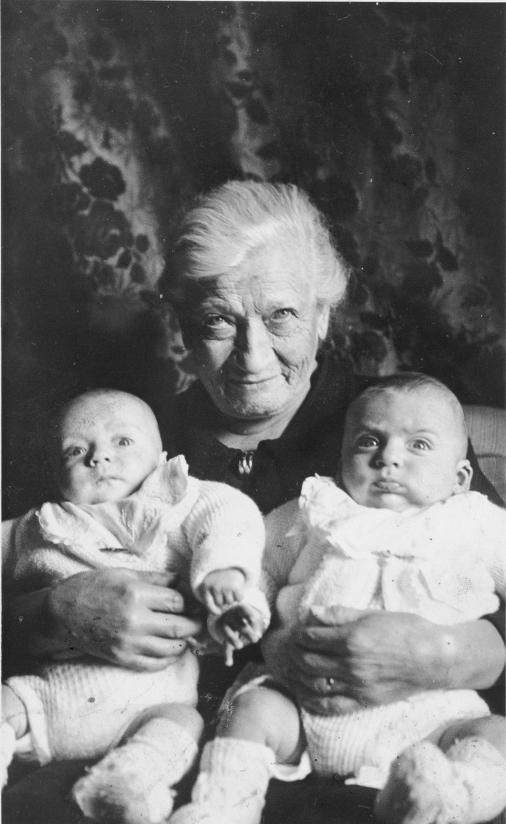 Anna Job holds her infant great-grandsons, Jean and Pierre Haas.