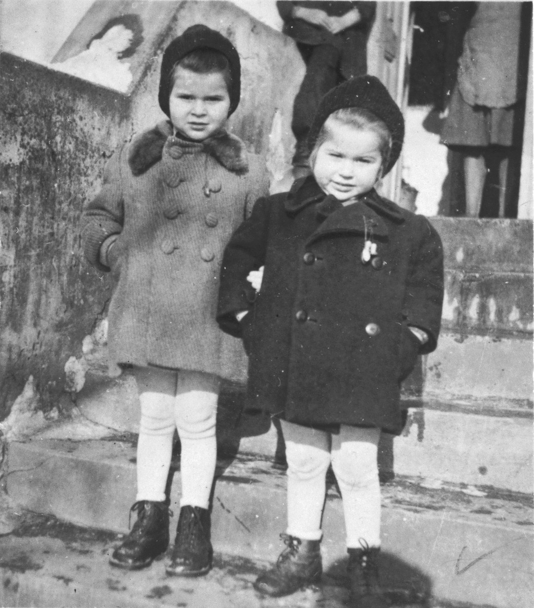 Two young Jewish sisters pose on the steps of their home in Cop.  Pictured are Renate (left) and Sylvia Schonberg.
