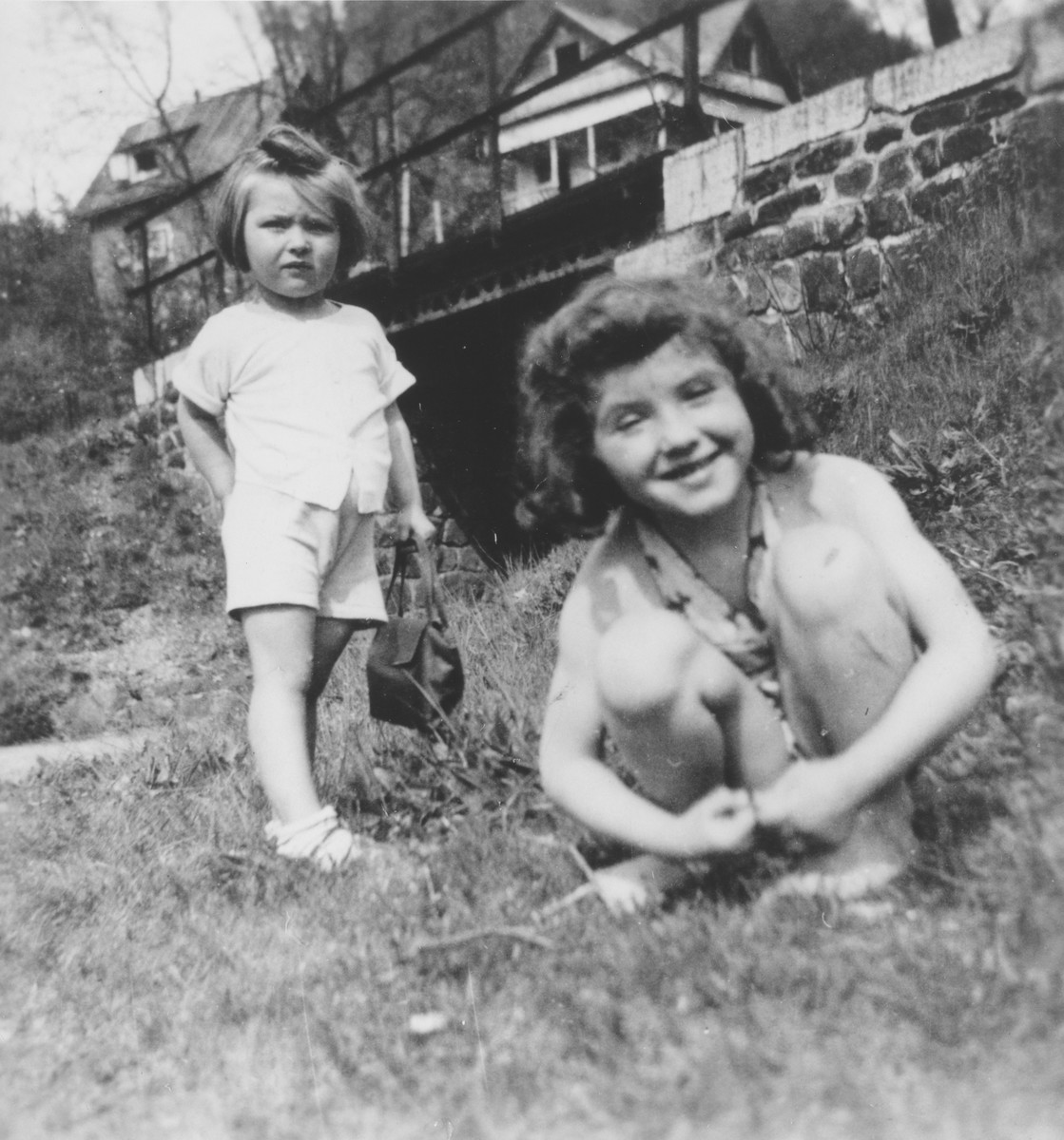 Judis Baehr plays with a friend one year after her liberation from Theresienstadt.