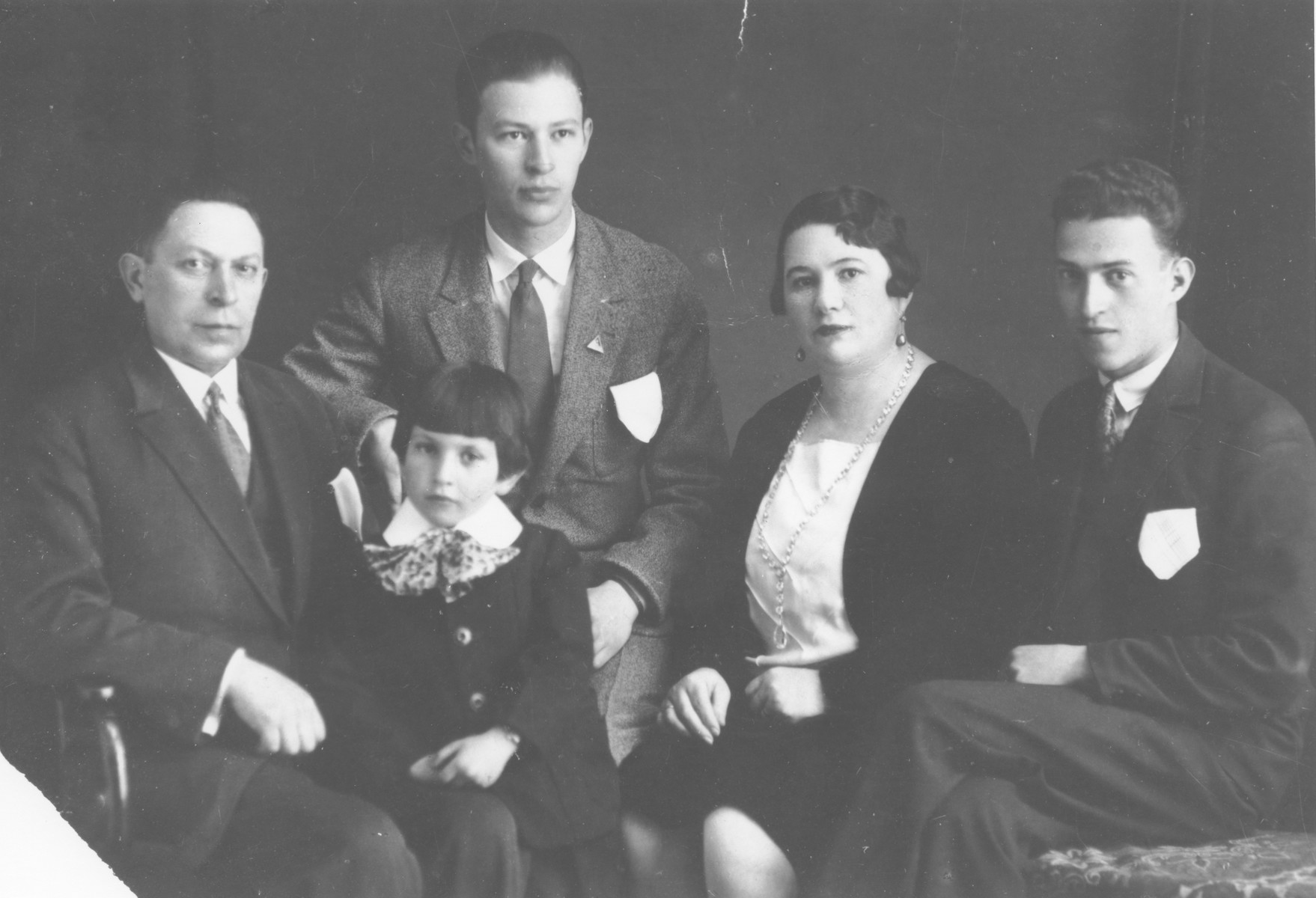 Portrait of the Genchik family in Riga, Latvia.  Pictured are Gdaly Hirsch and Rocha Zelda Genchik and their three children, Israel, Abram and Mordkha.