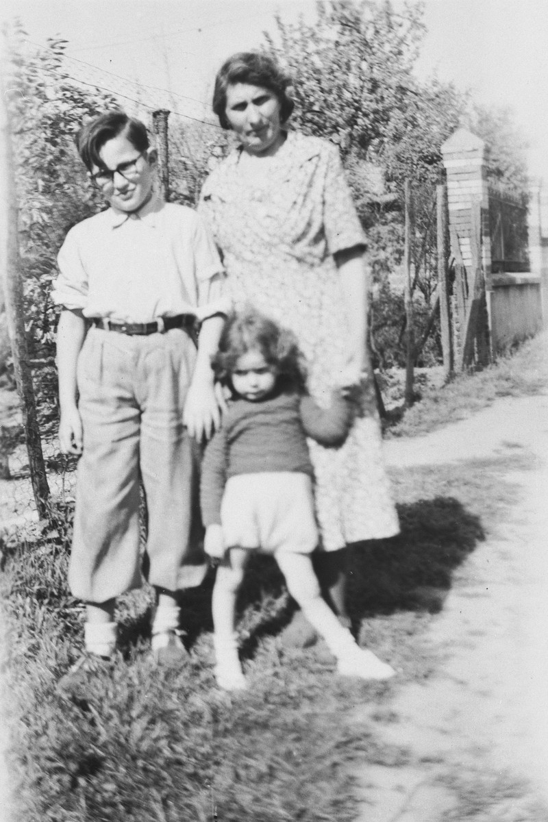 Rene Lichtman poses in a garden with his Helene and older cousin.  His cousin was later deported to a concentration camp where he perished