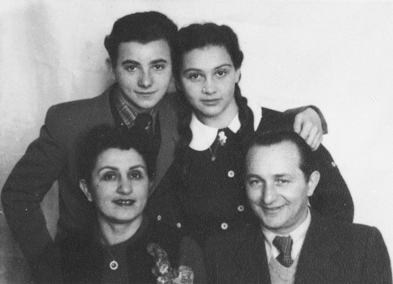 Portrait of the Eichenholz family in the Krakow ghetto.  Pictured are Lusia and Henryk Eichenholz with their children Bronislaw and Dziunia.